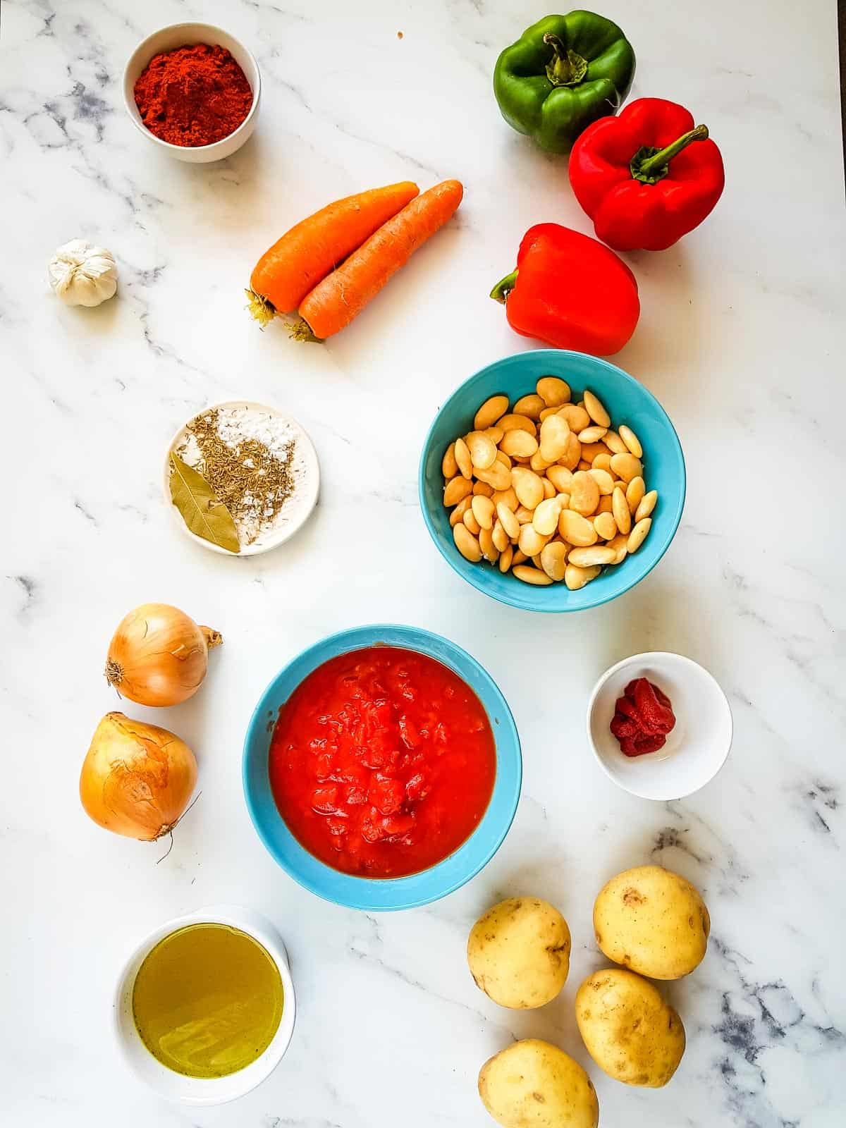 The ingredients for vegetable goulash laid out on a table.