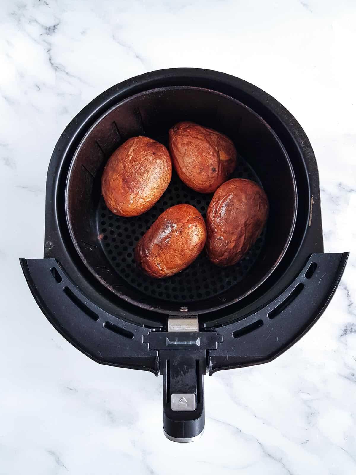 Baked potatoes in an air fryer.