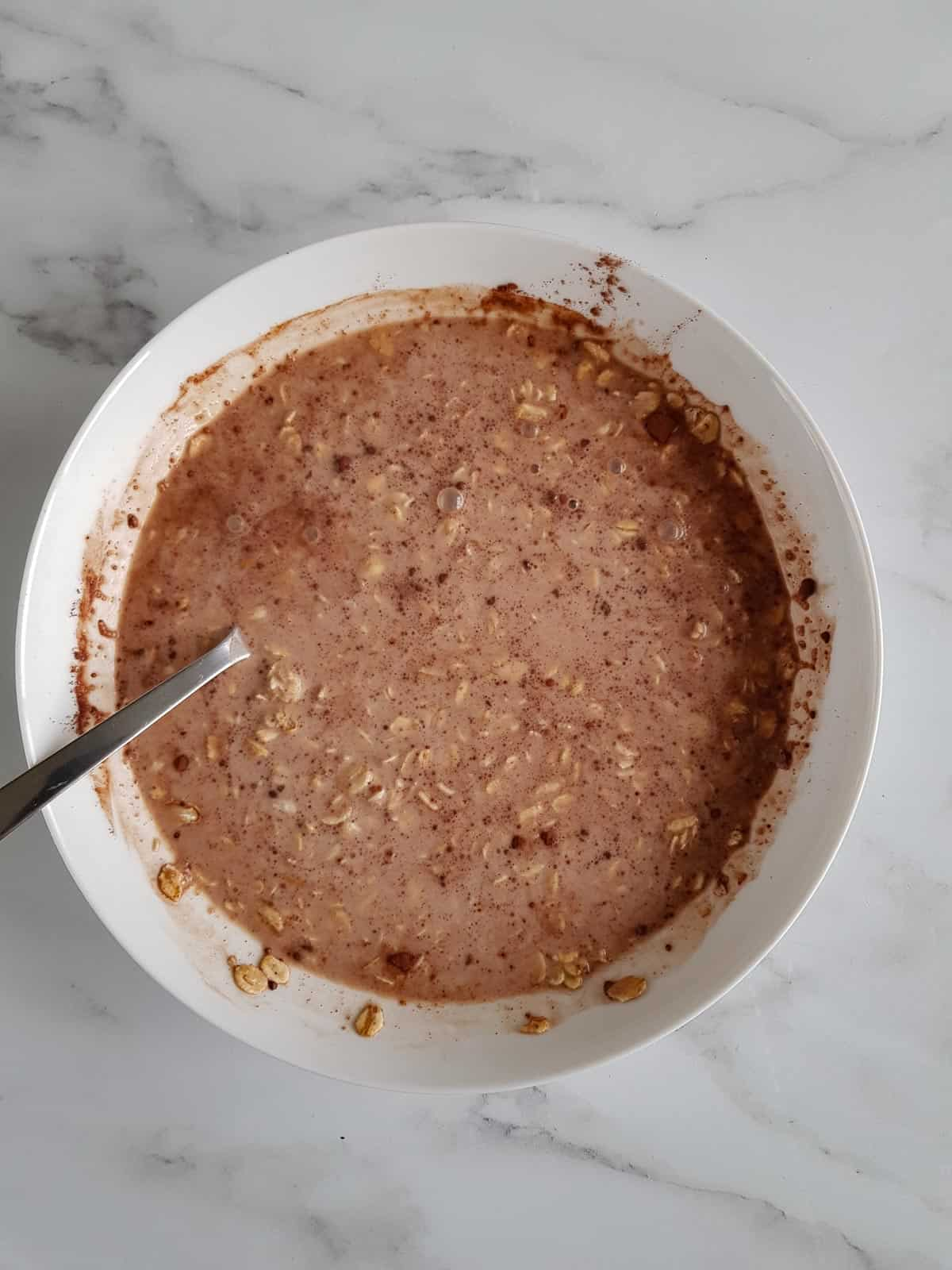 Making chocolate oats in a bowl.
