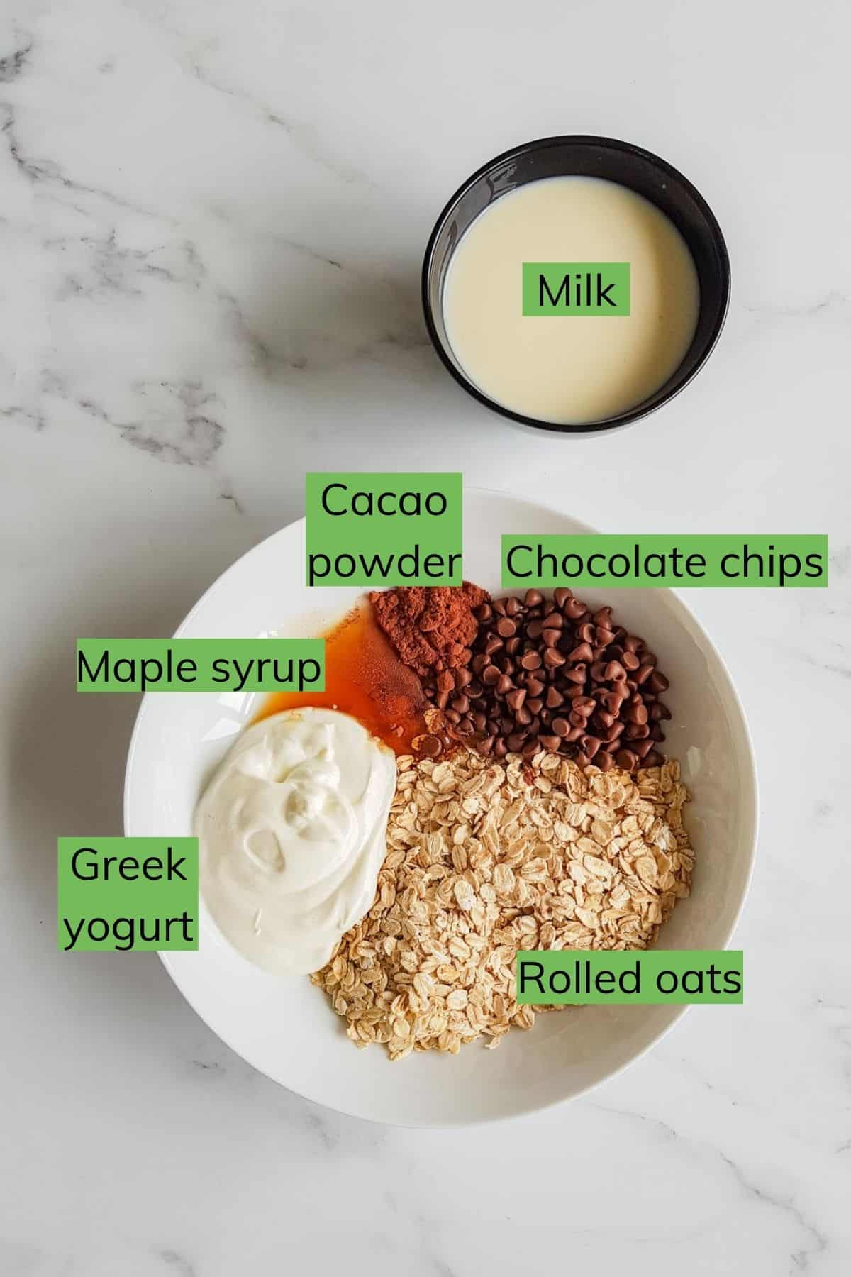 The ingredients required to make chocolate overnight oats laid out on a table.