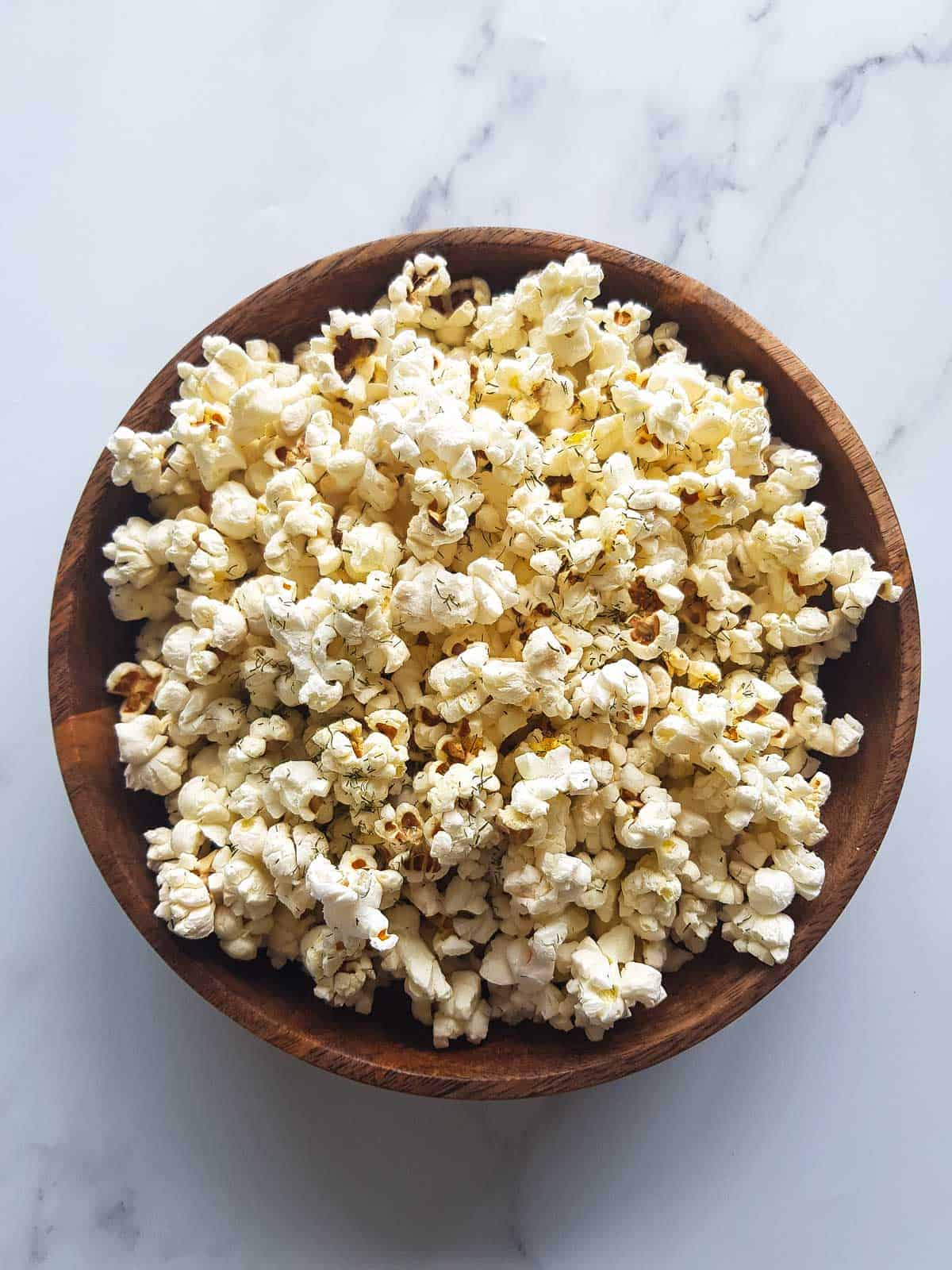 A bowl of dill pickle popcorn.