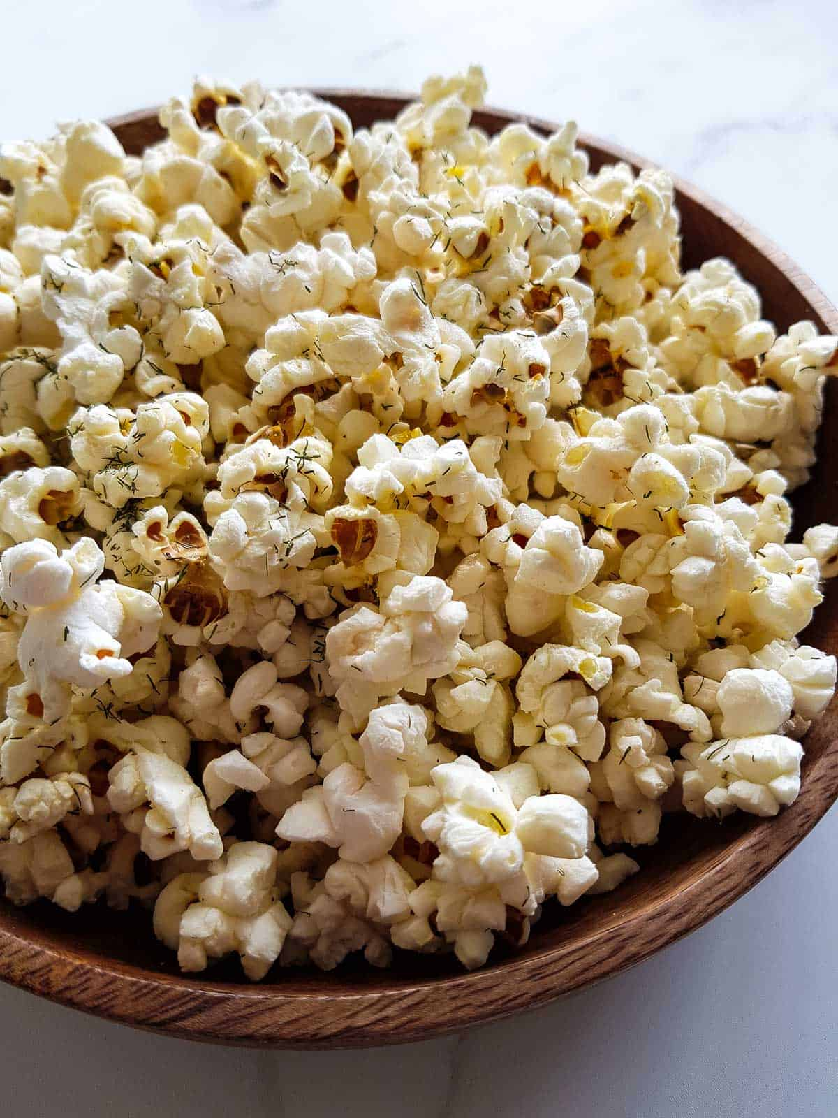 Close up of dill pickle popcorn.