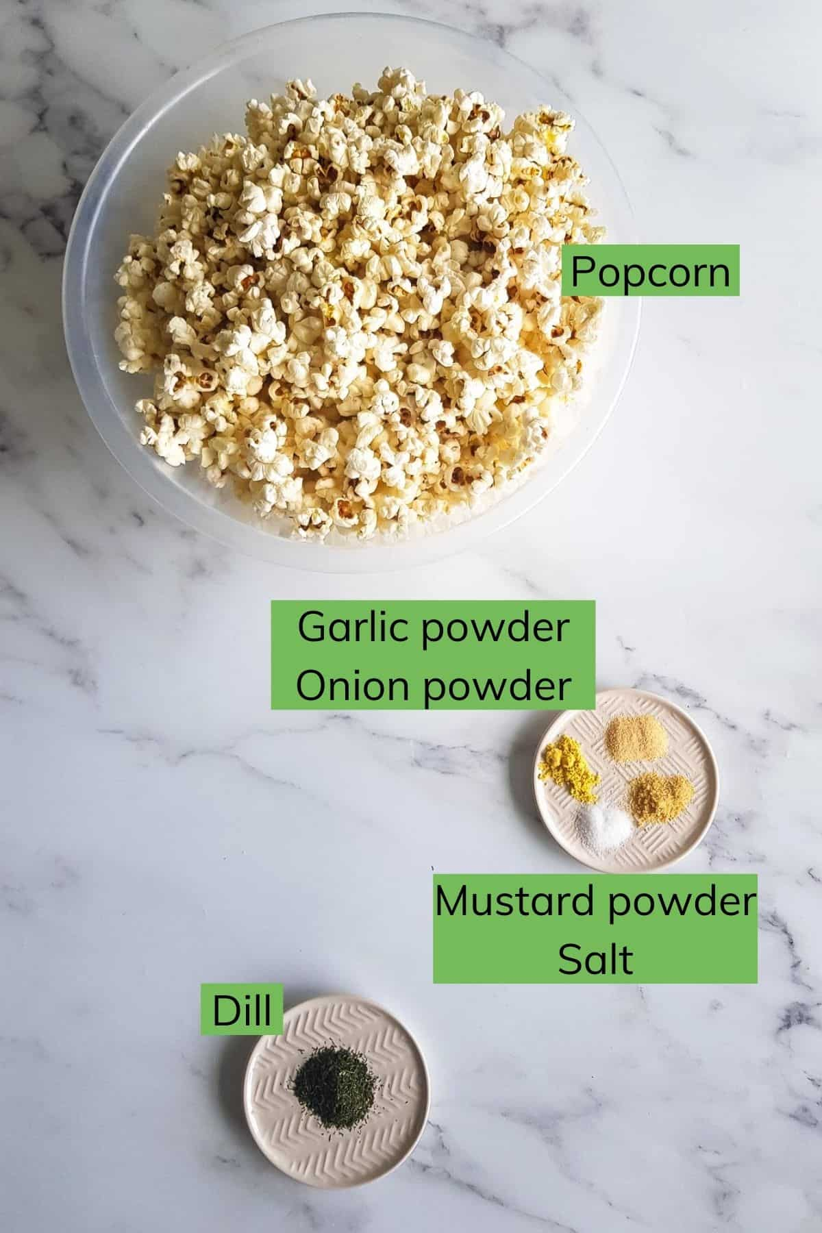 The ingredients for dill pickle popcorn laid out on a table.