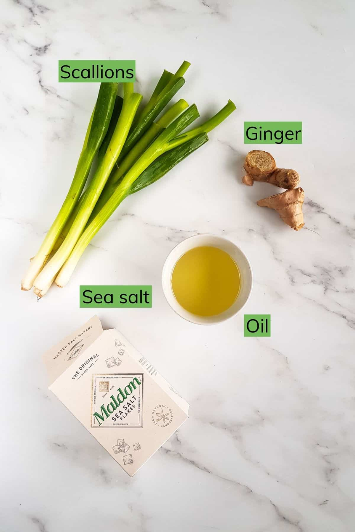 Ingredients needed to make ginger scallion sauce on a table.