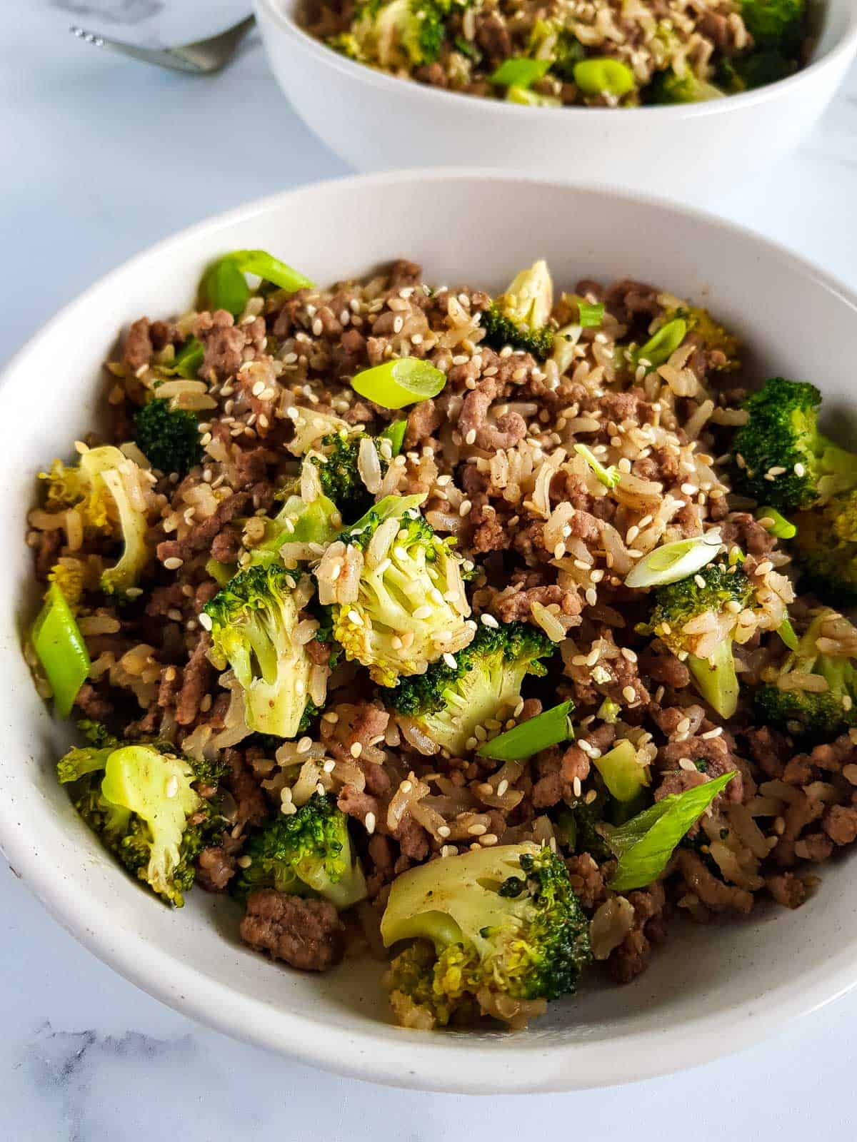 Ground beef and broccoli stir fry in a bowl.