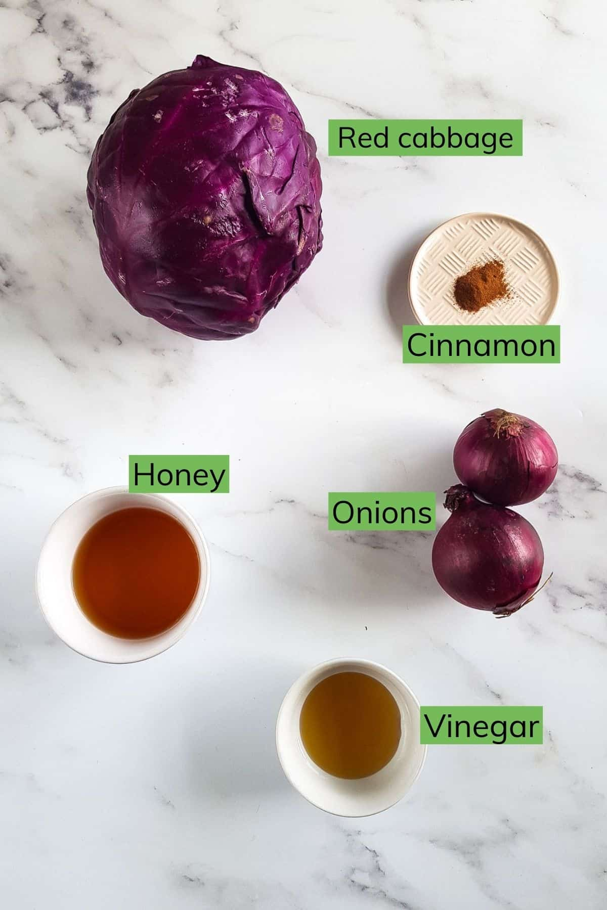 The ingredients needed to make the red cabbage laid out on a table.