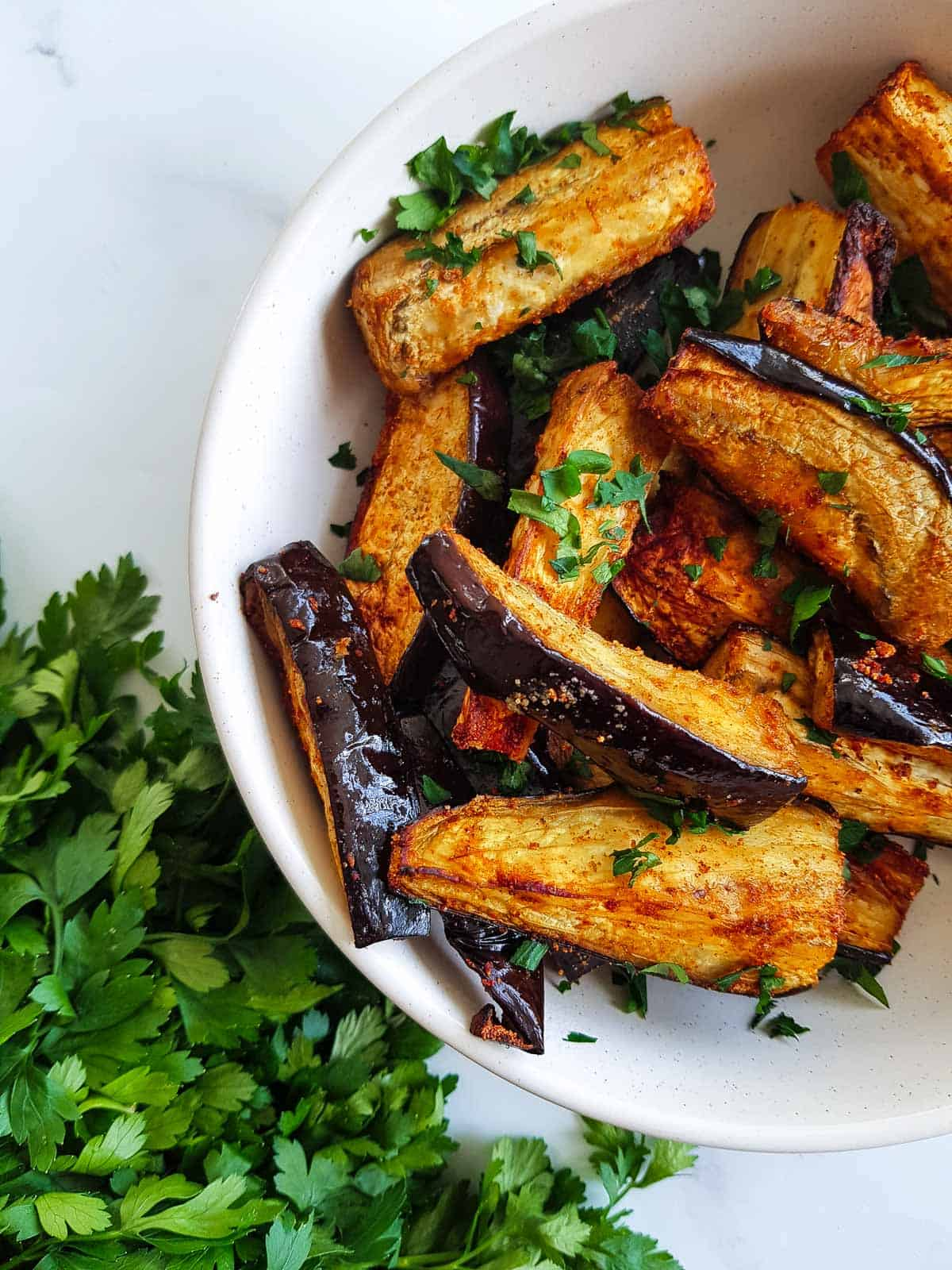 Air fryer eggplant fries in a bowl.