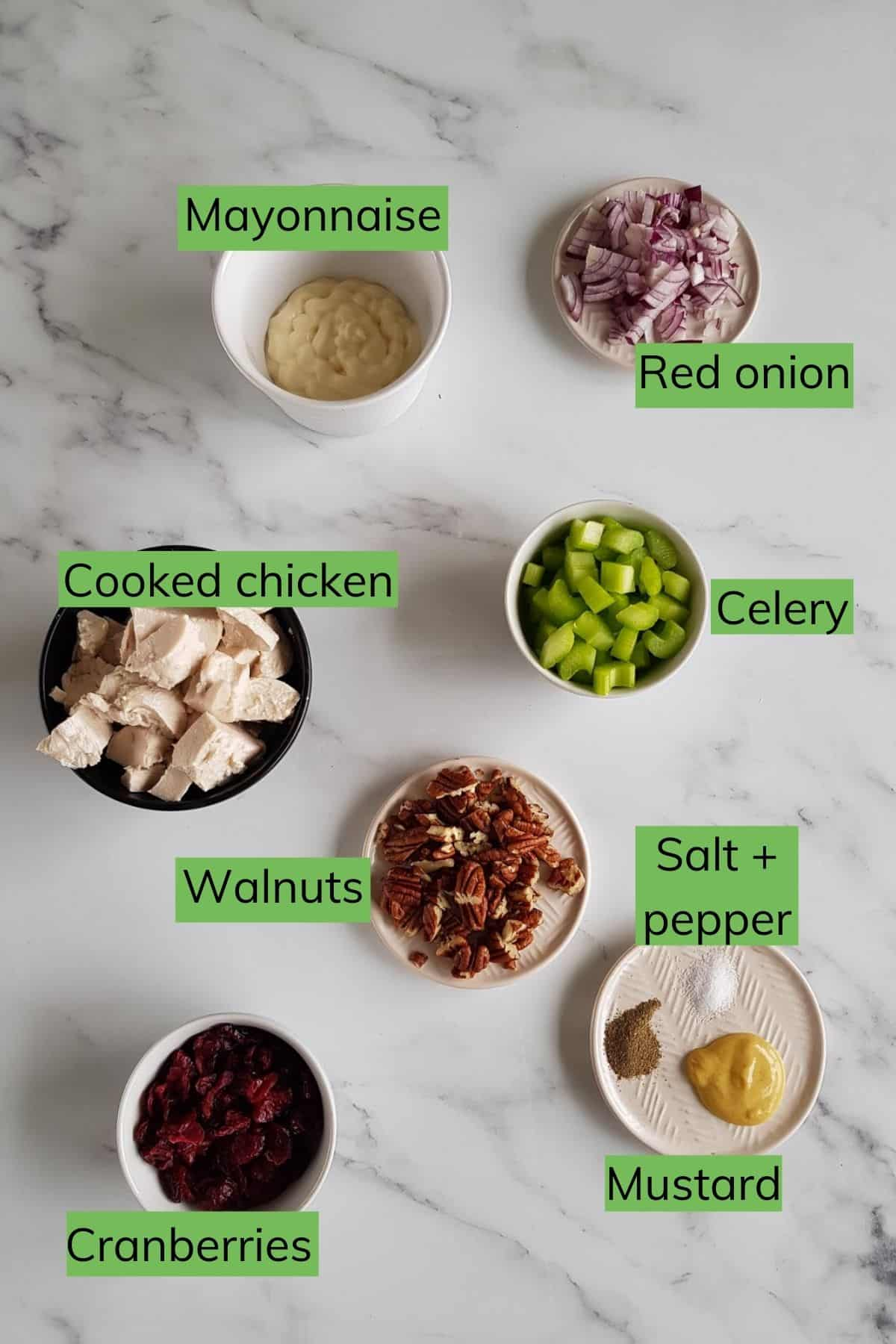 Ingredients for cranberry chicken salad laid out on a table.