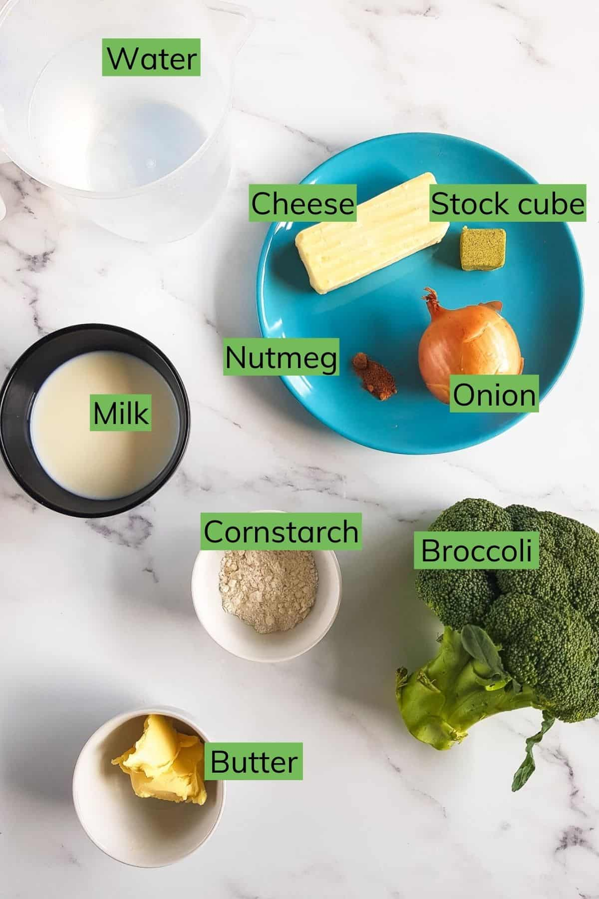 The ingredients for broccoli cheese soup laid out on a table.
