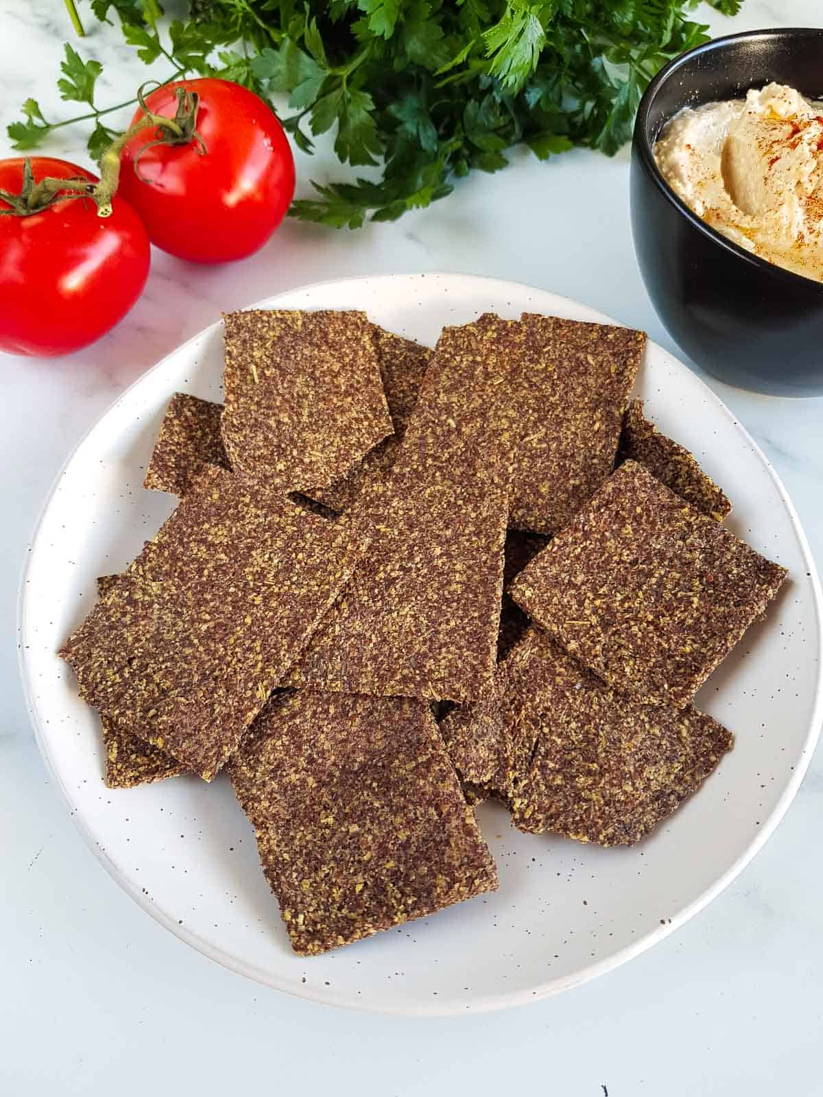 A plate full of flaxseed crackers.