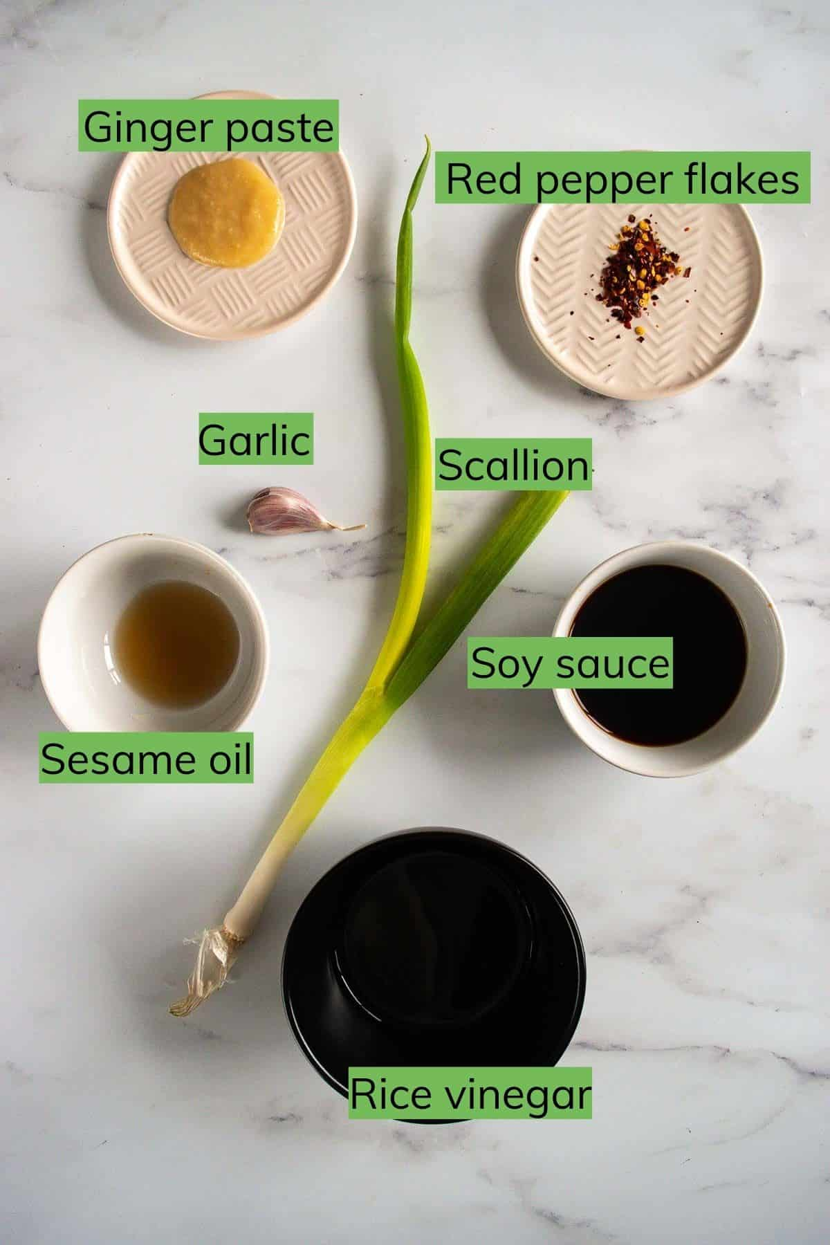 Ingredients required to make gyoza sauce laid out on a table.