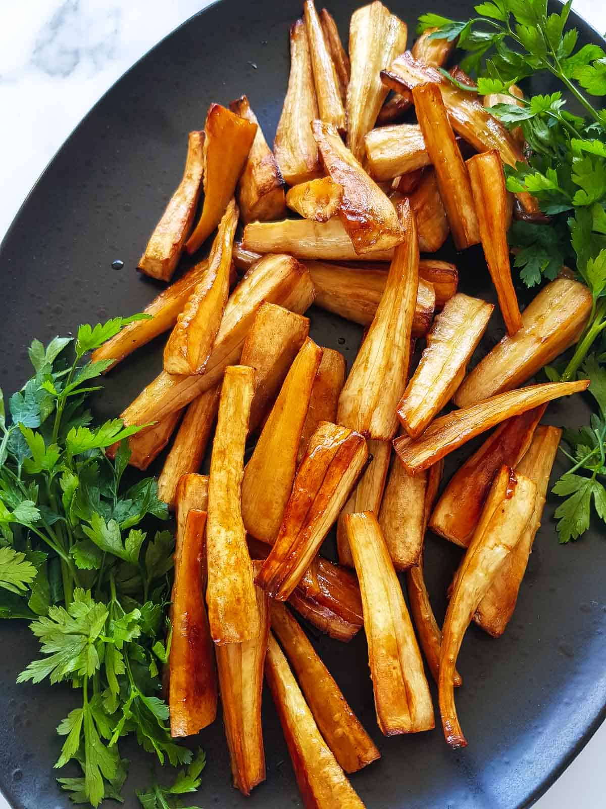 Close up of honey glazed parsnips.