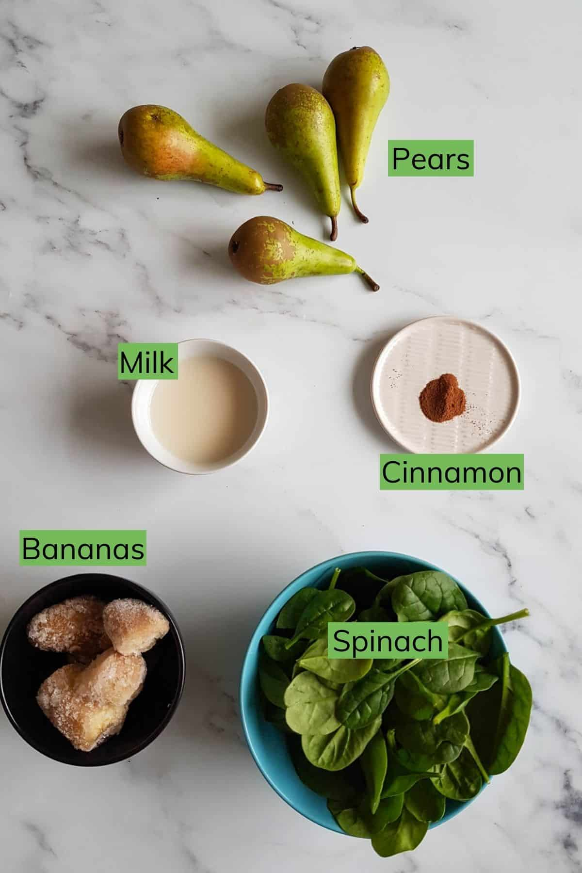 The ingredients required to make pear smoothie laid out on a table.