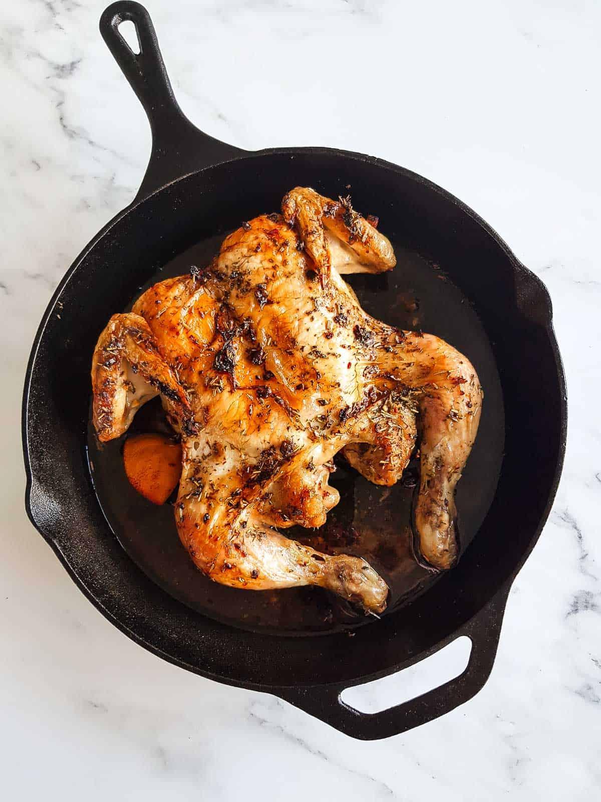 Roast butterflied chicken in a cast iron skillet.