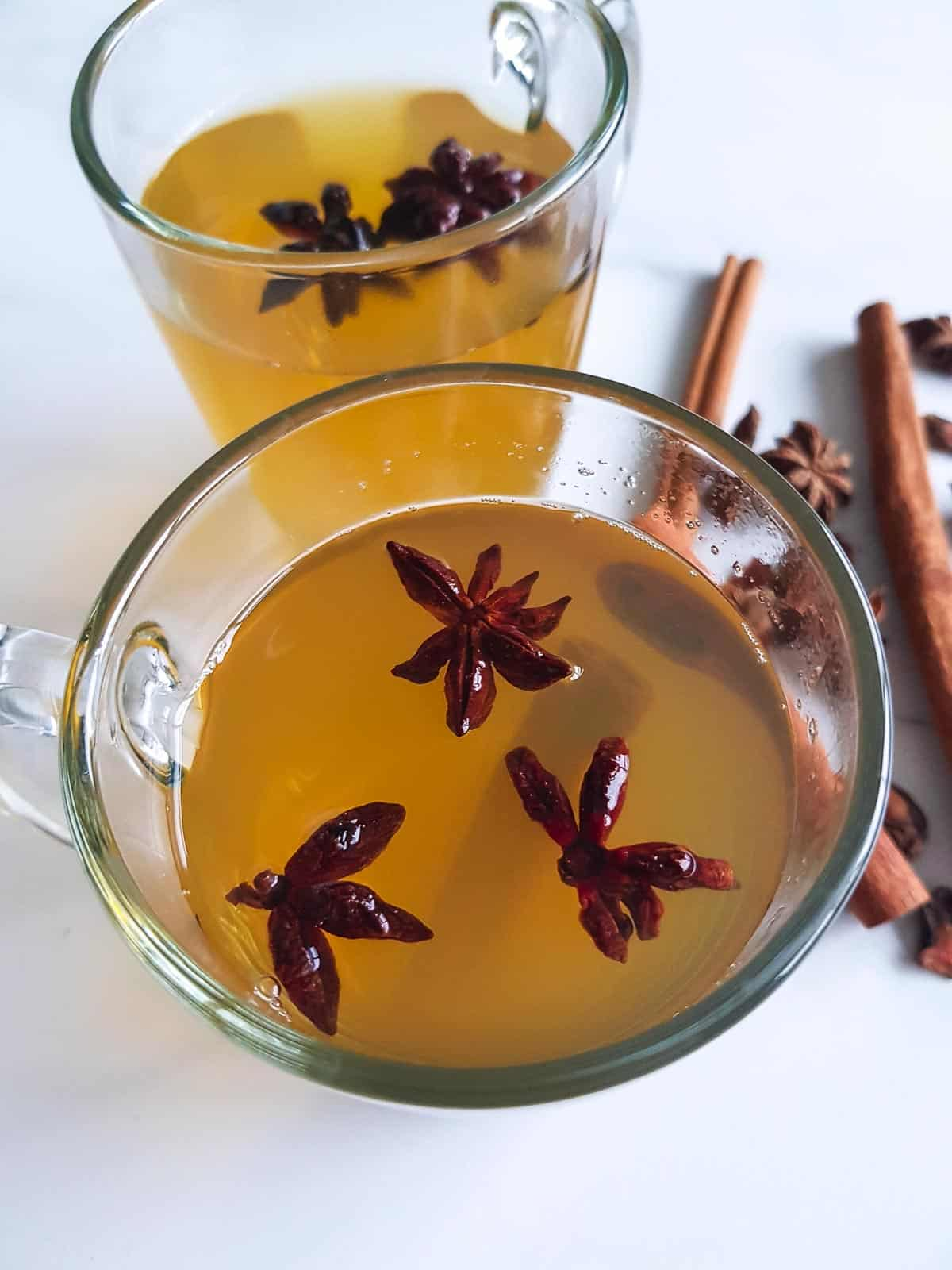 Close up of a cup of tea with star anise.