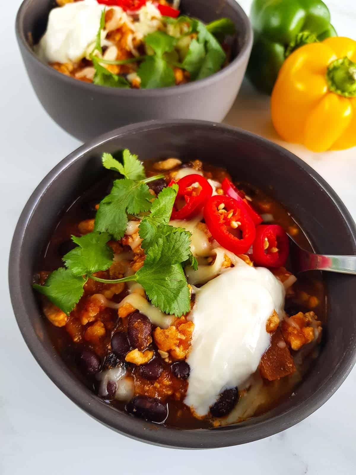 Close up of a bowl of turkey sweet potato chili.