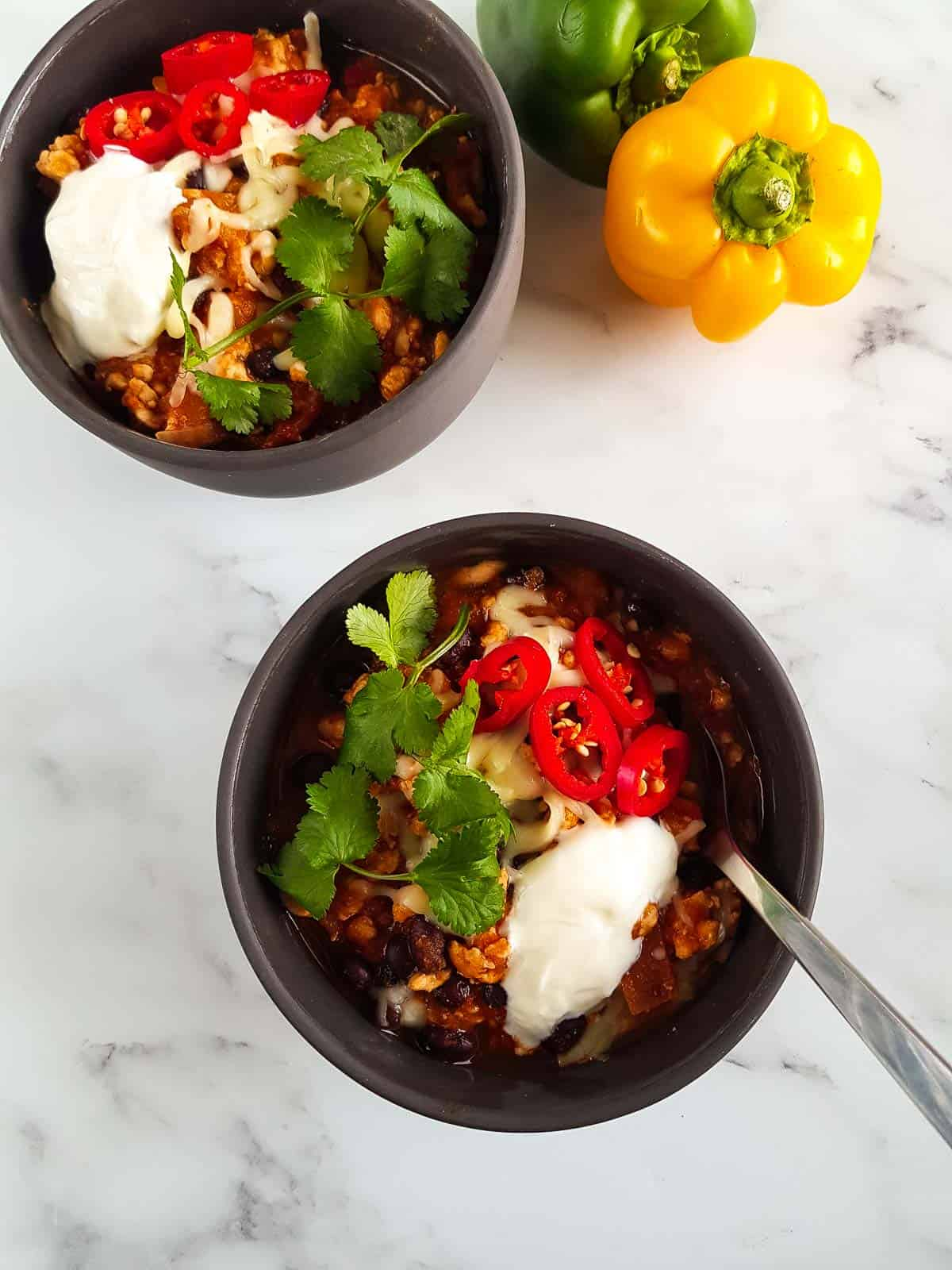 Overhead view of bowls filled with chili.