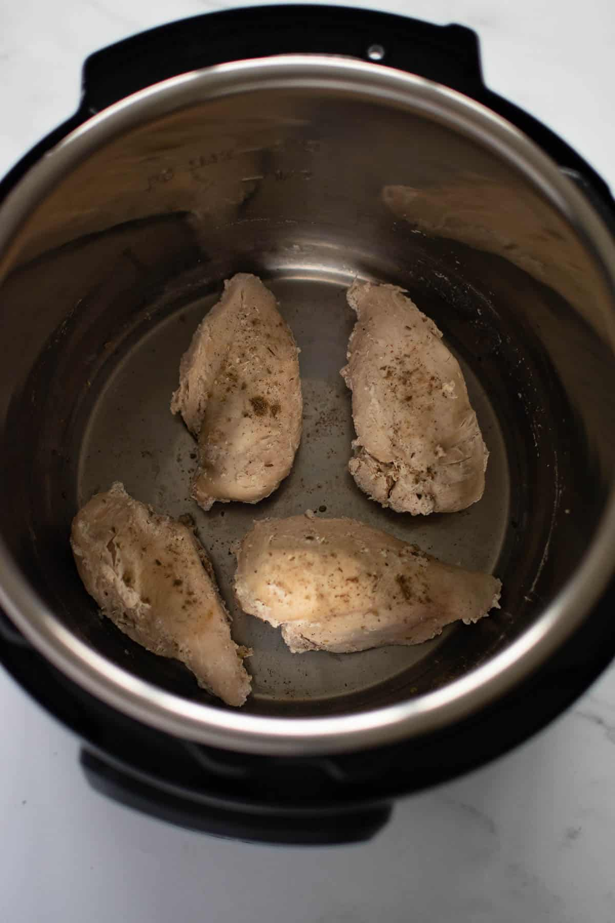 Cooked chicken breasts in an instant pot.