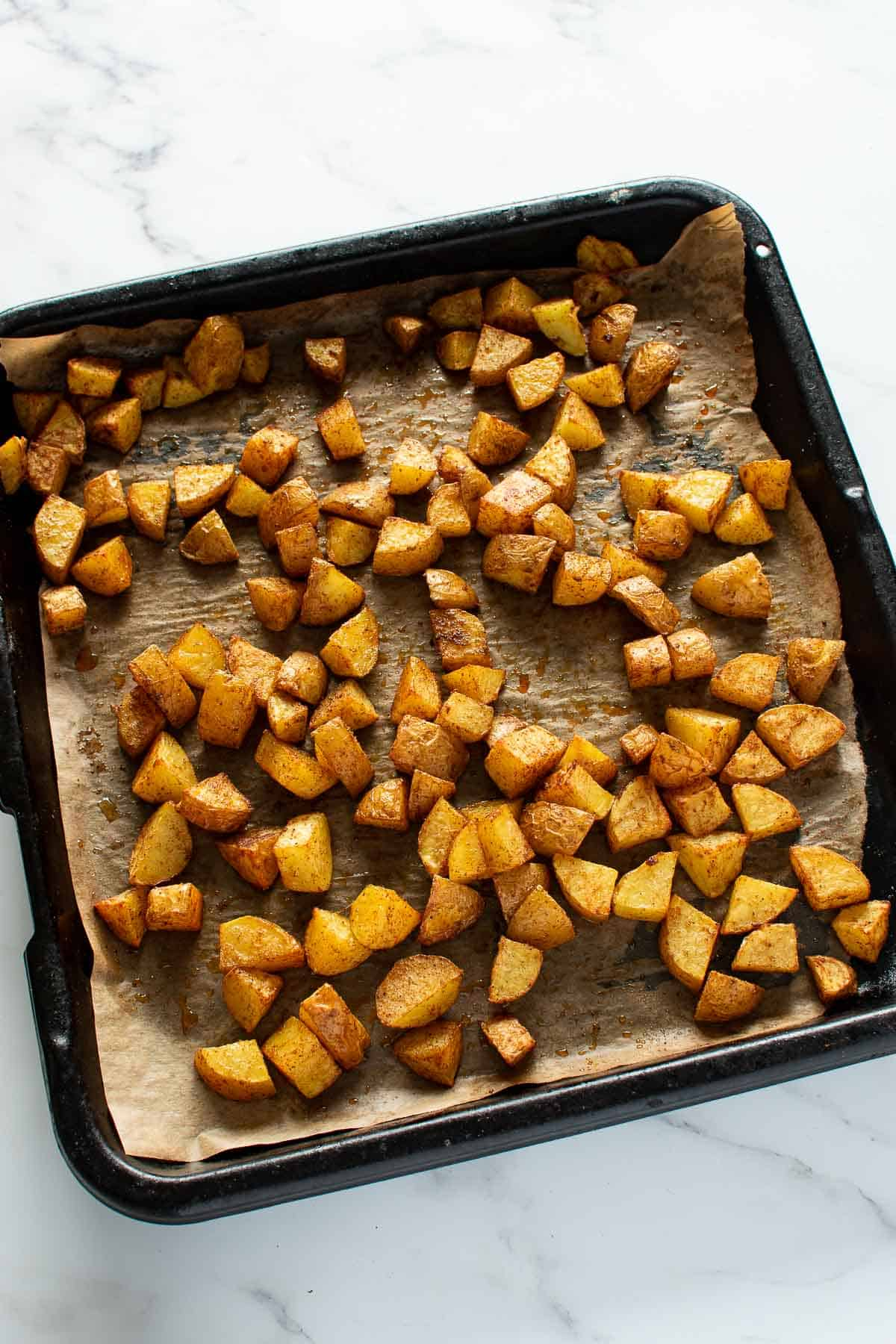 A sheet pan with roast Mexican potatoes.