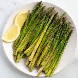 Air fried asparagus on a plate.