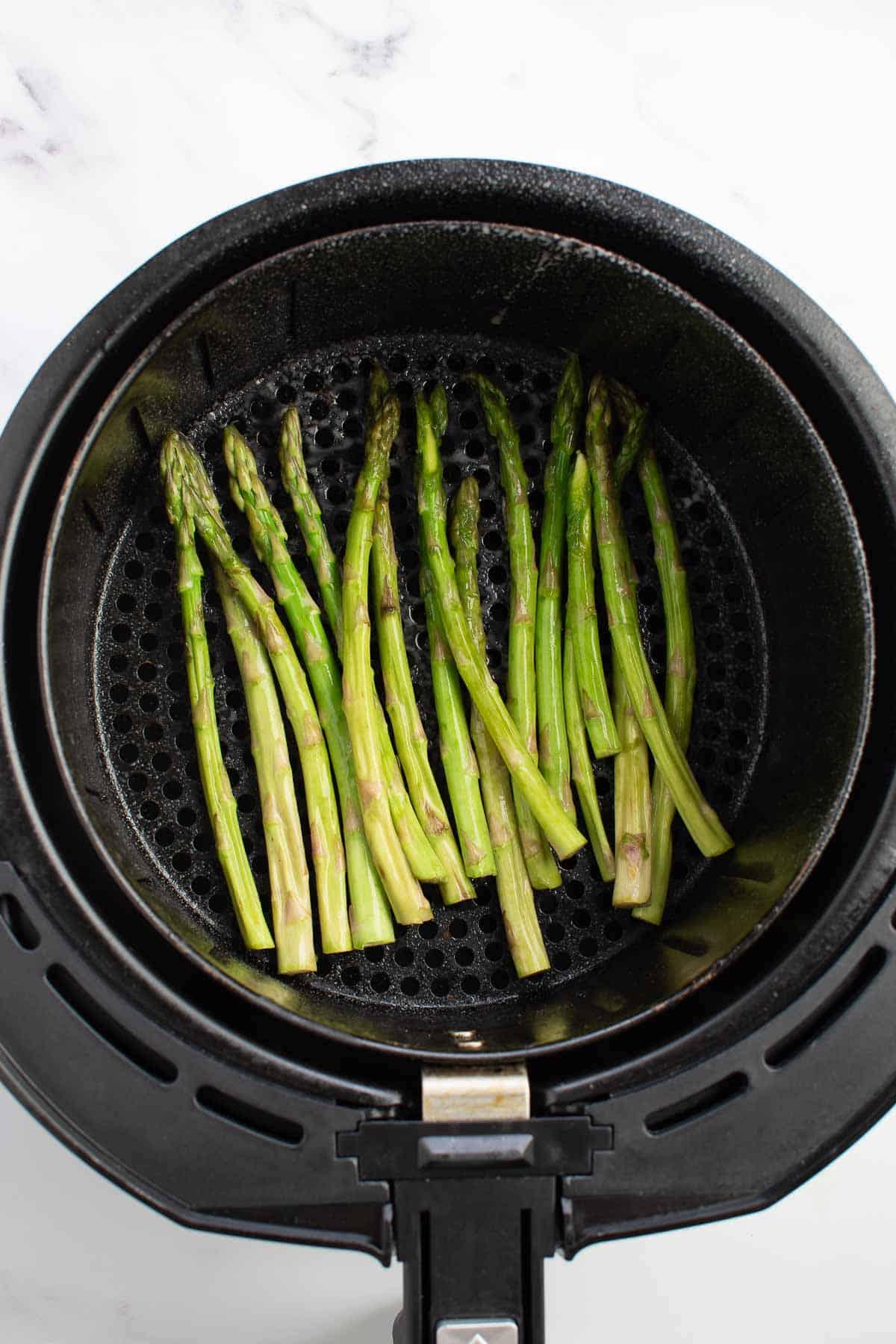 Asparagus in an air fryer.