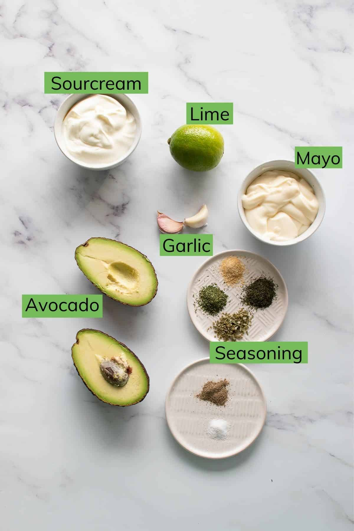 Ingredient required to make avocado ranch laid out on a table.