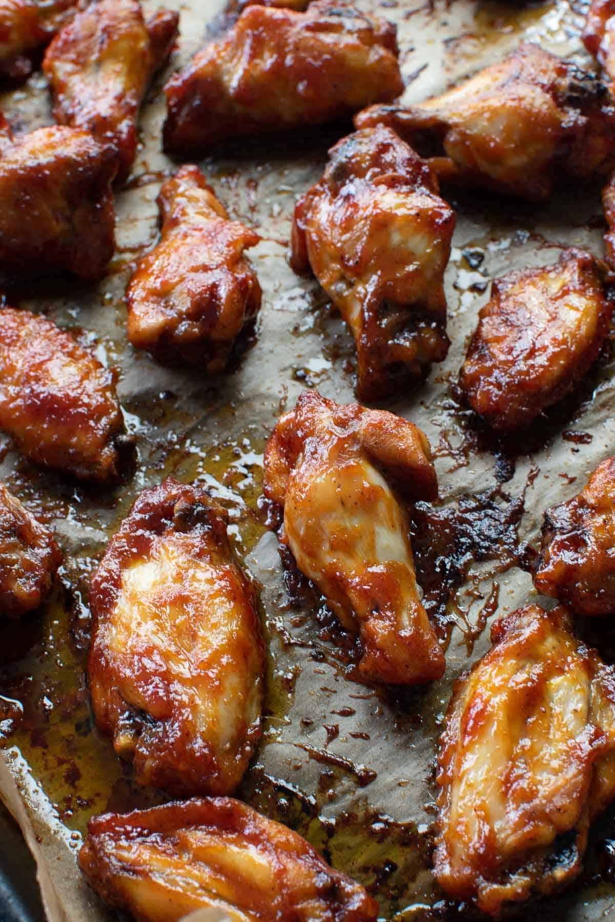 BBQ glazed wings on a baking sheet.