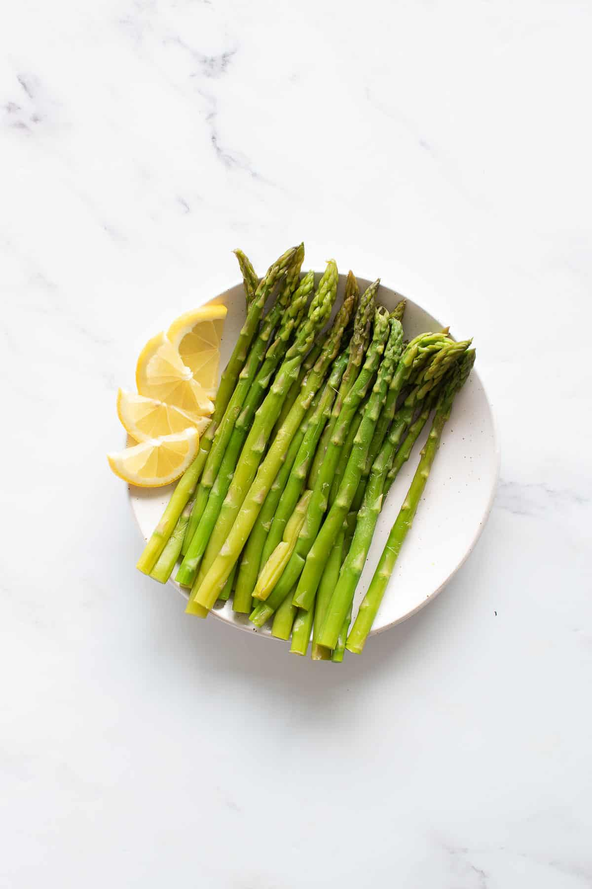 Pressure cooked asparagus on a plate.