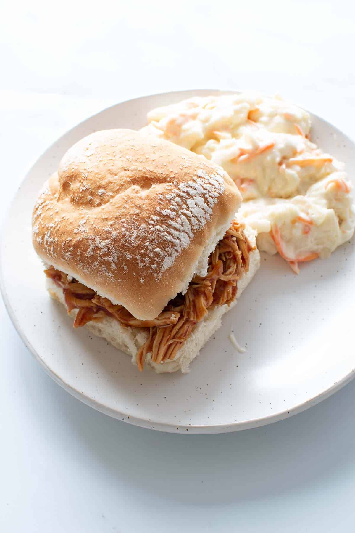 Pulled BBQ chicken sandwich with coleslaw.