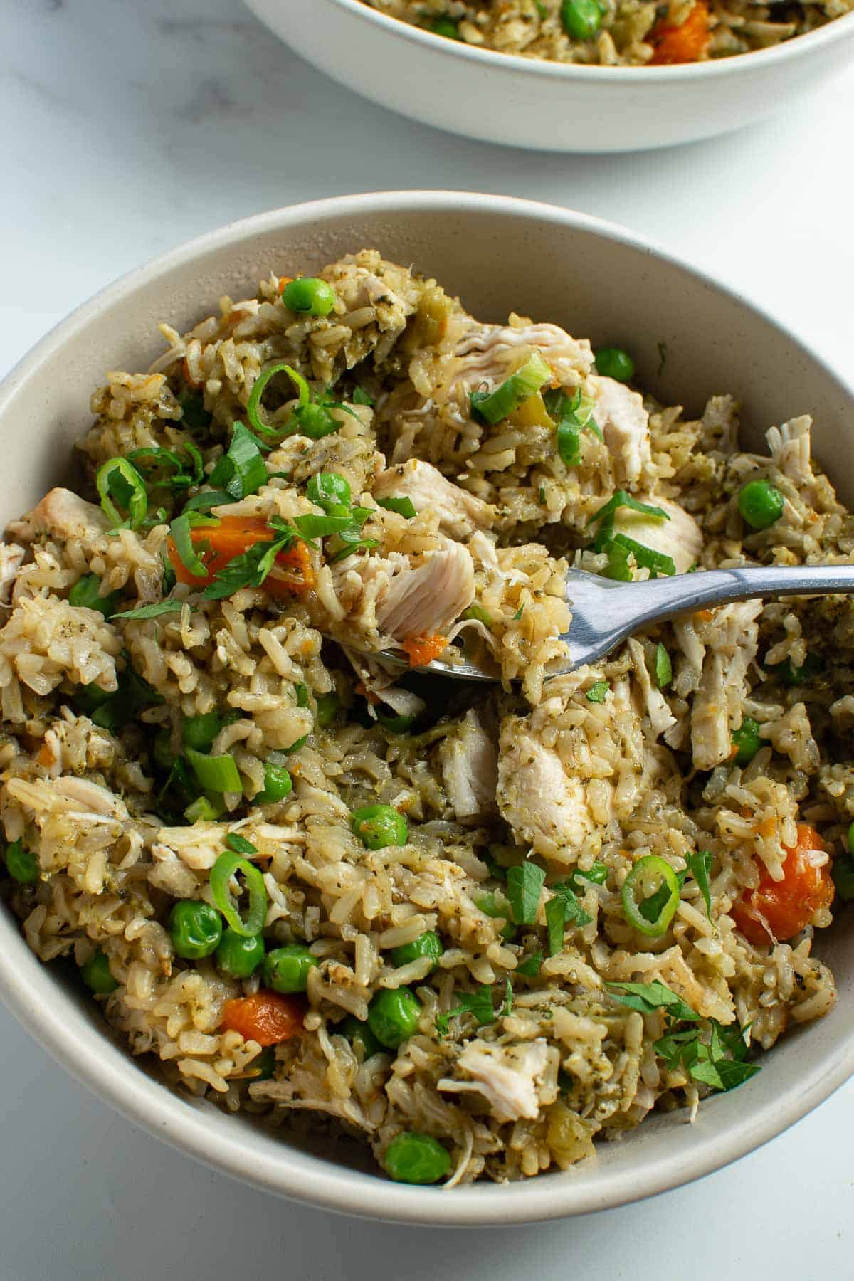 Instant pot chicken and rice garnished with parsley and scallions.