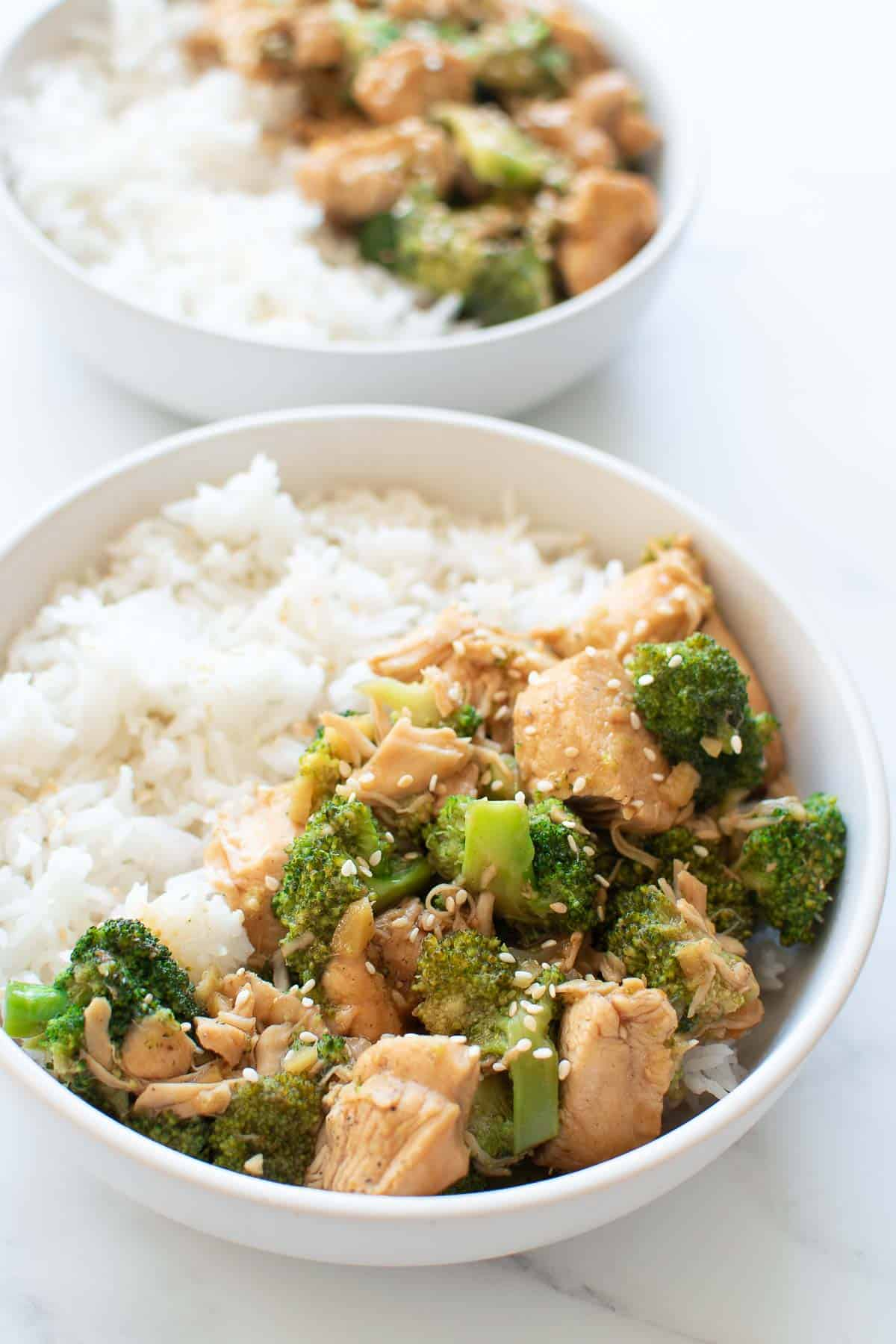 Bowls of pressure cooked broccoli and chicken with rice.