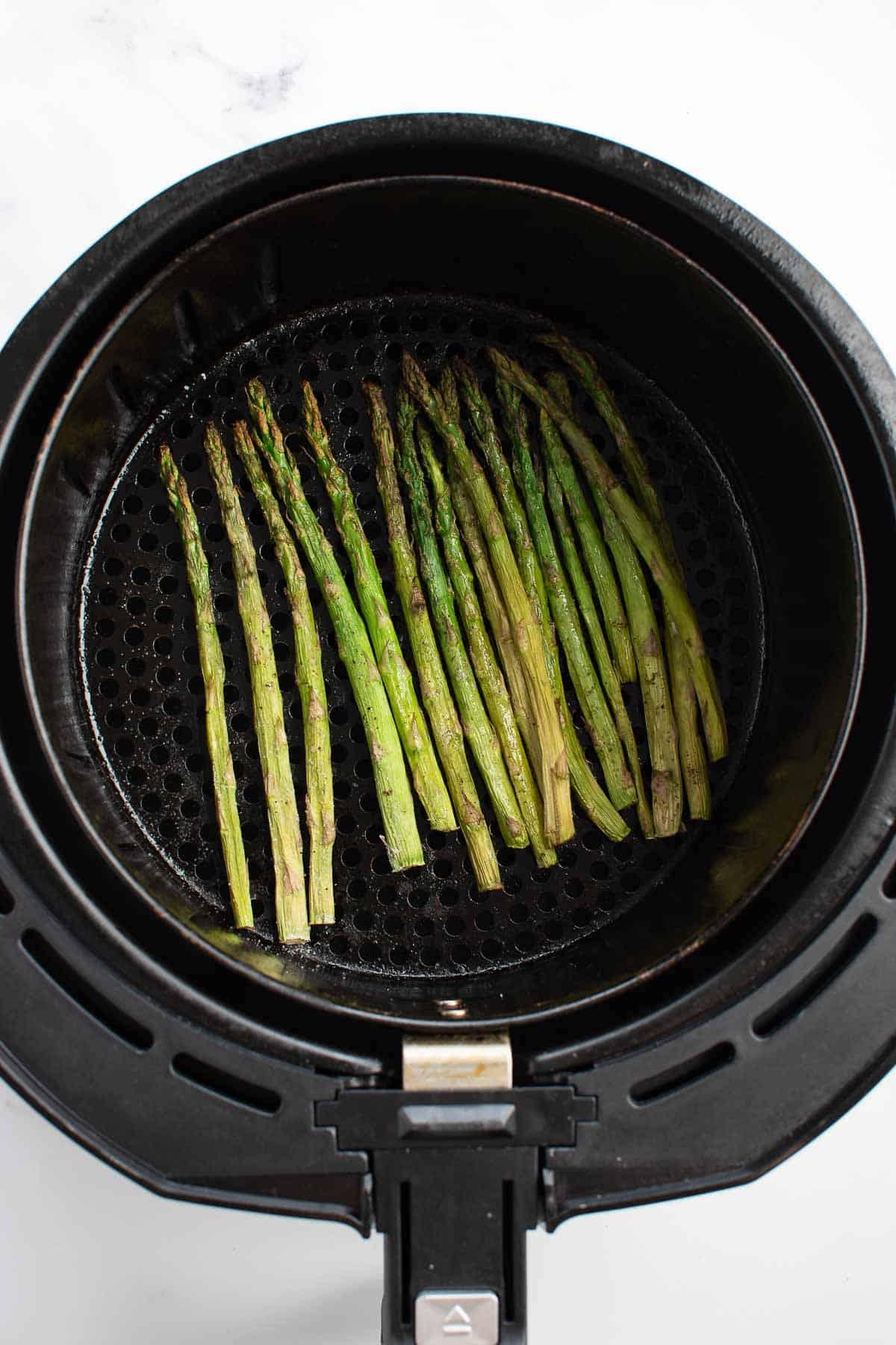 Roasted asparagus in an air fryer.
