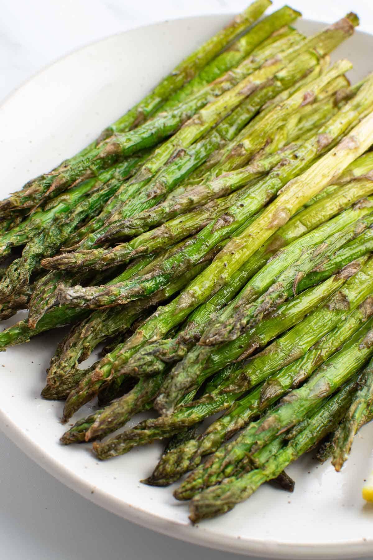 Roasted asparagus on a plate.