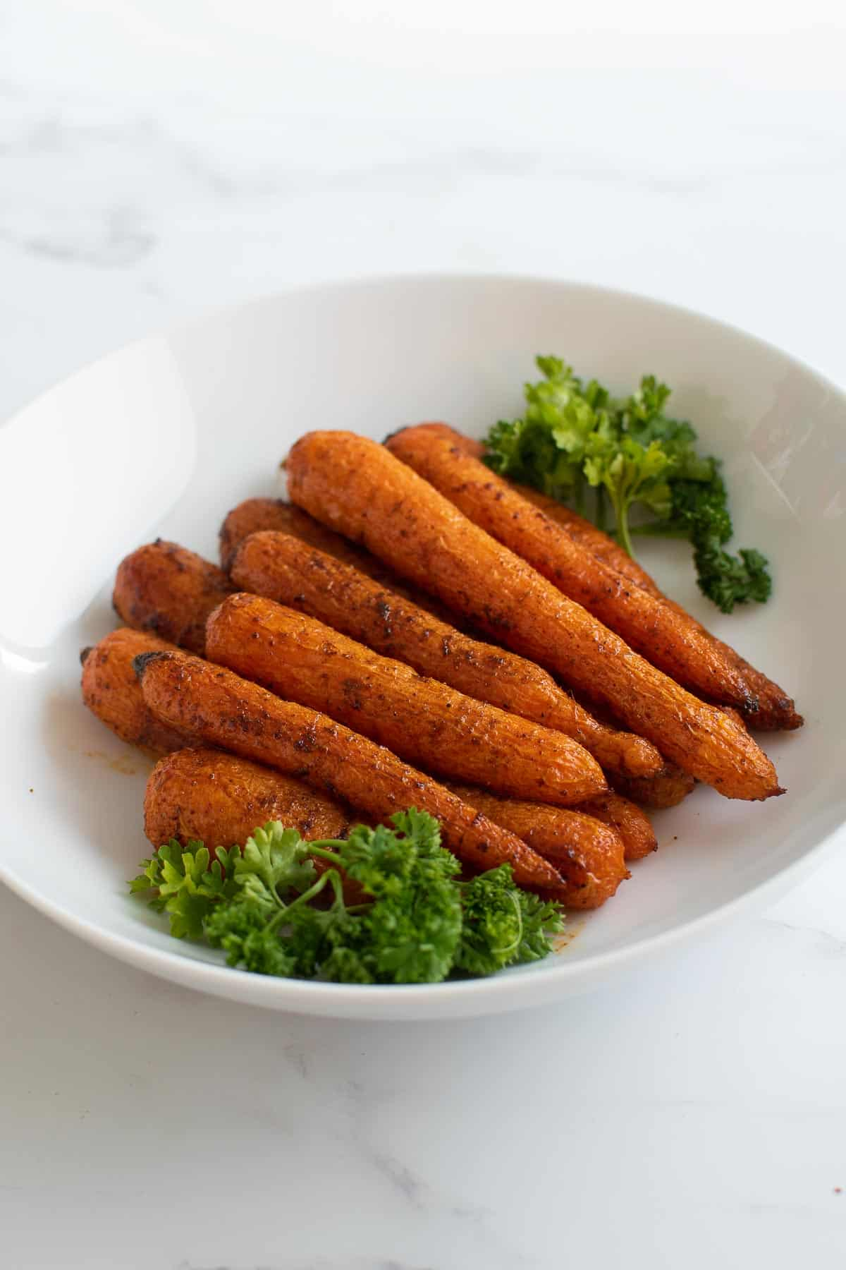 A bowl of spicy roasted carrots.