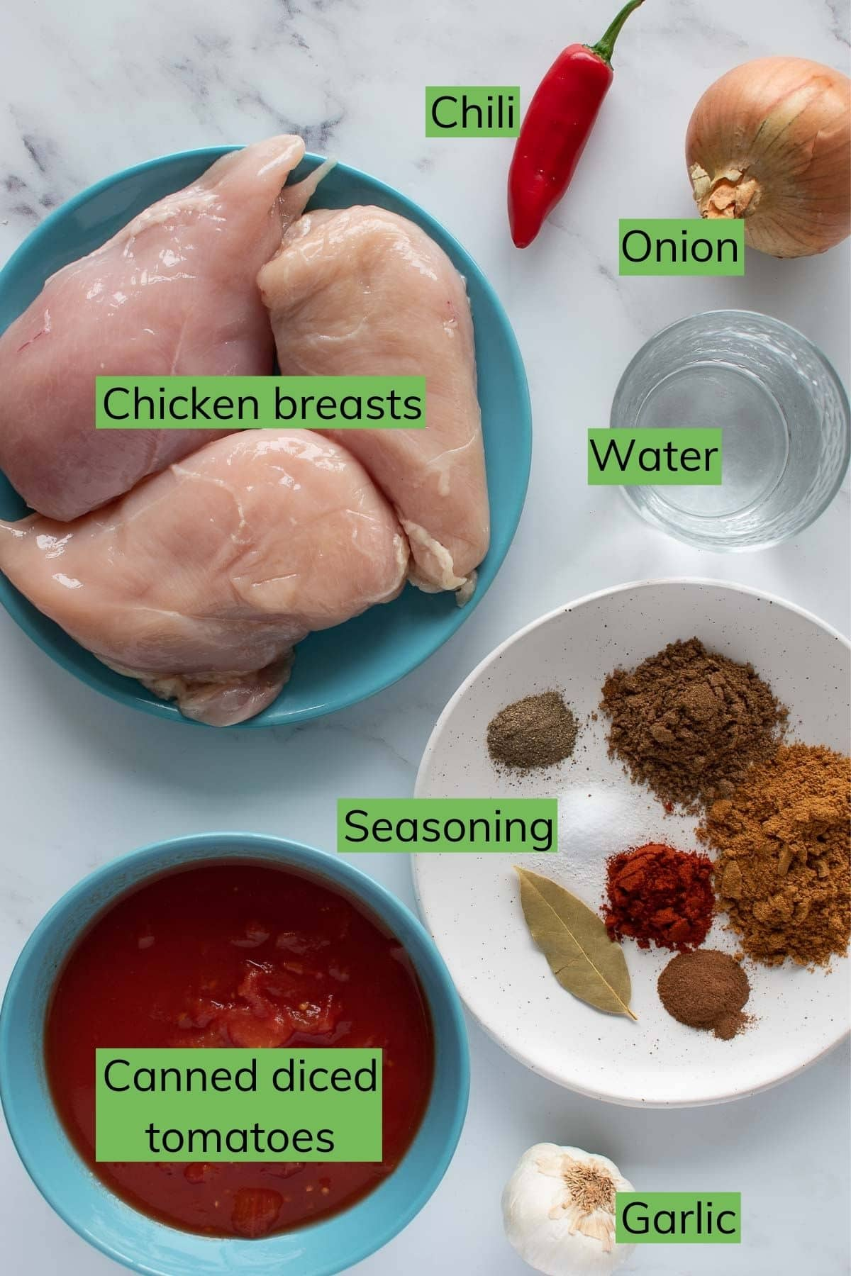 The ingredients for Instant Pot chicken curry laid out on a table.