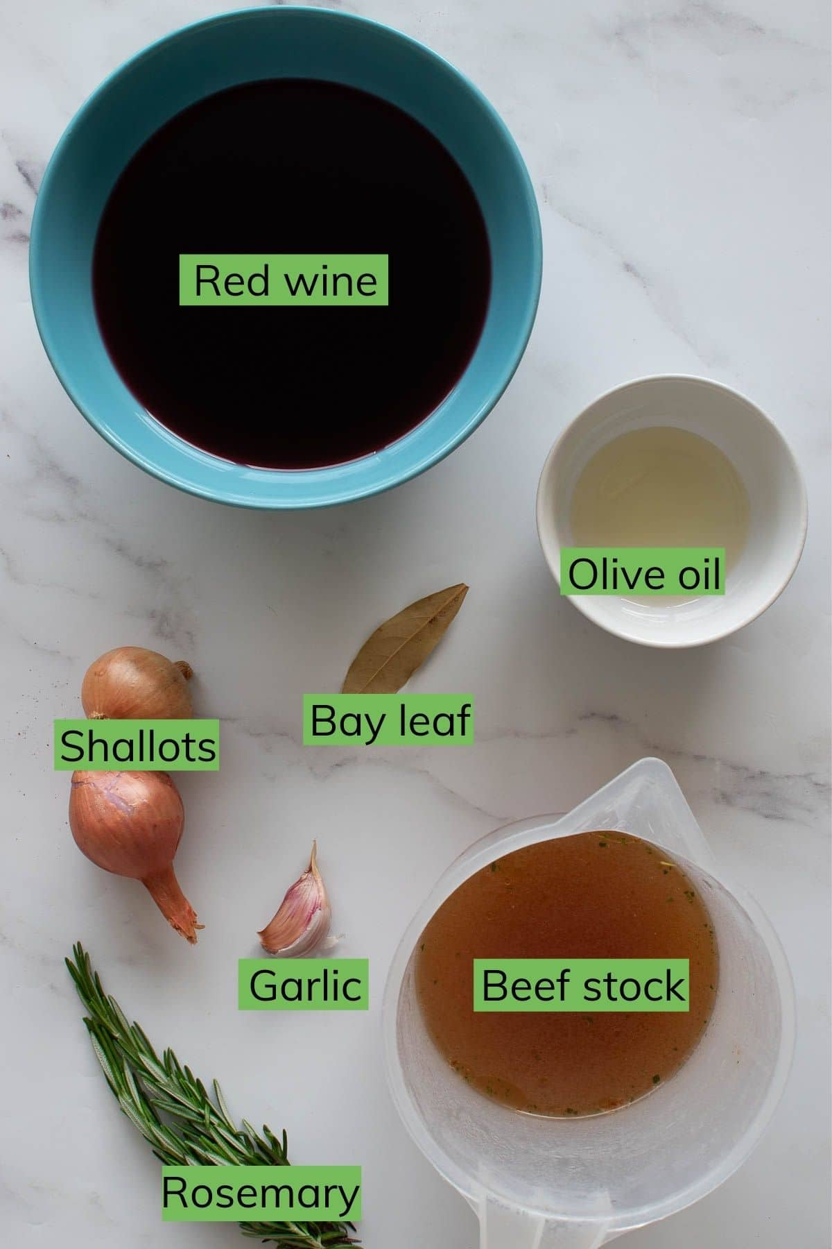The ingredients for red wine jus laid out on a table.