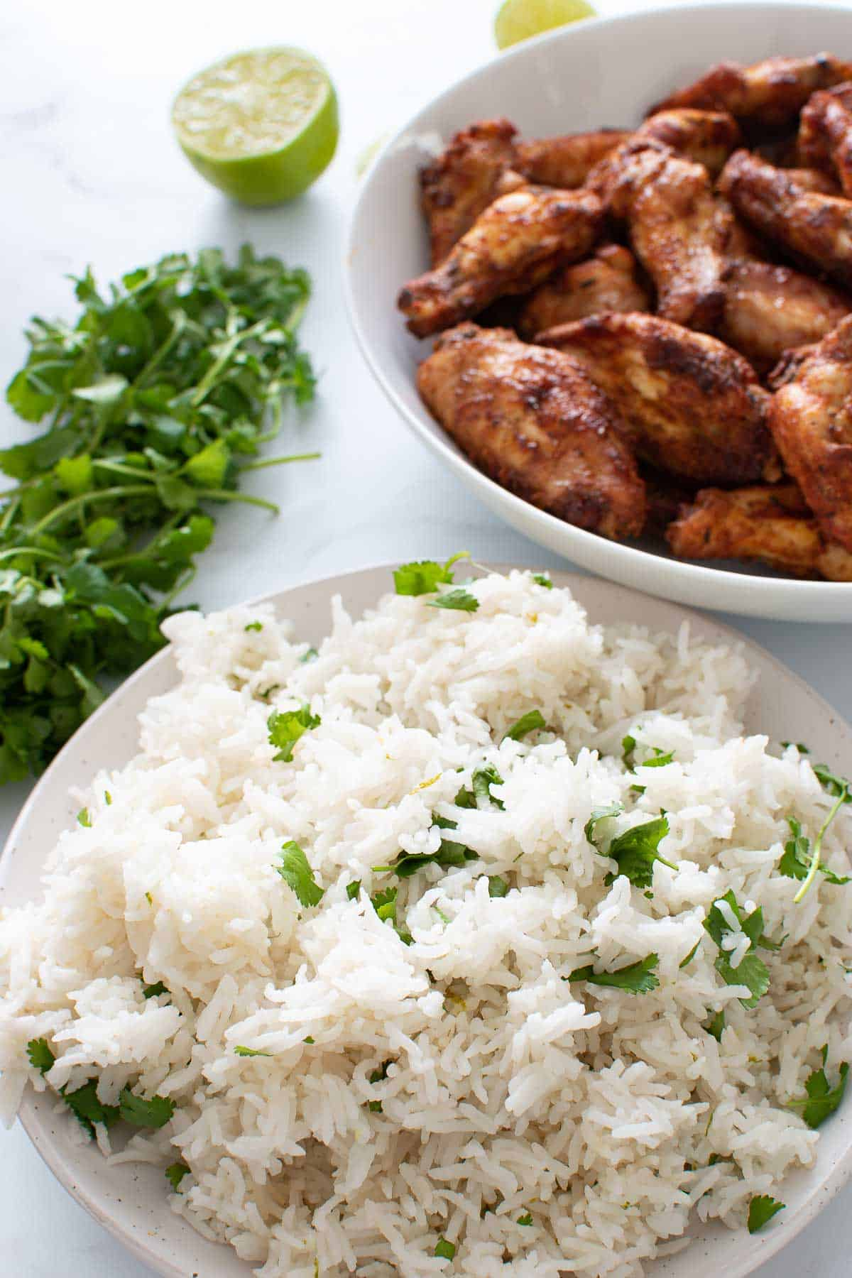 Lime and cilantro rice with chicken wings on the side.