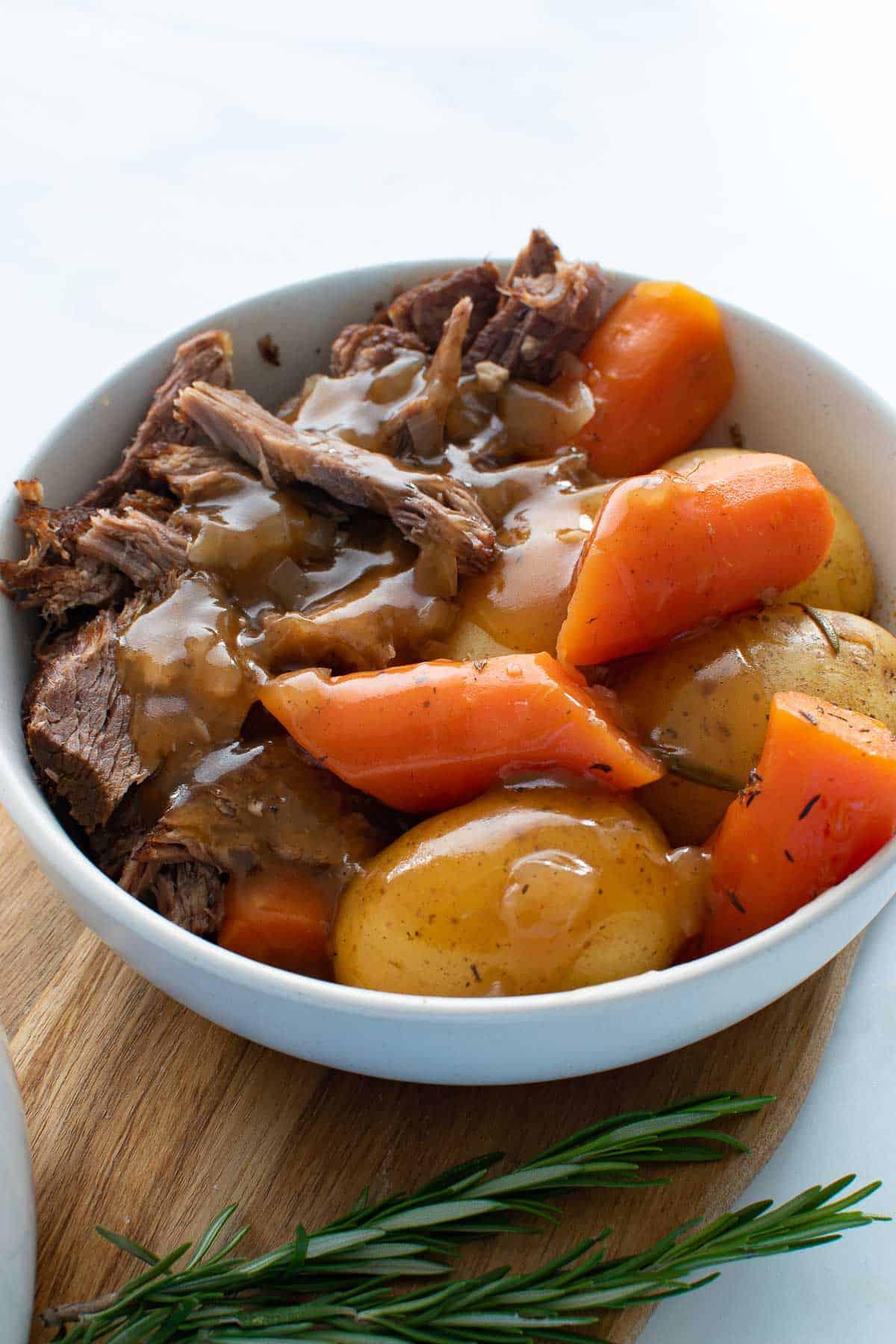 Close up of a bowl of pot roast.