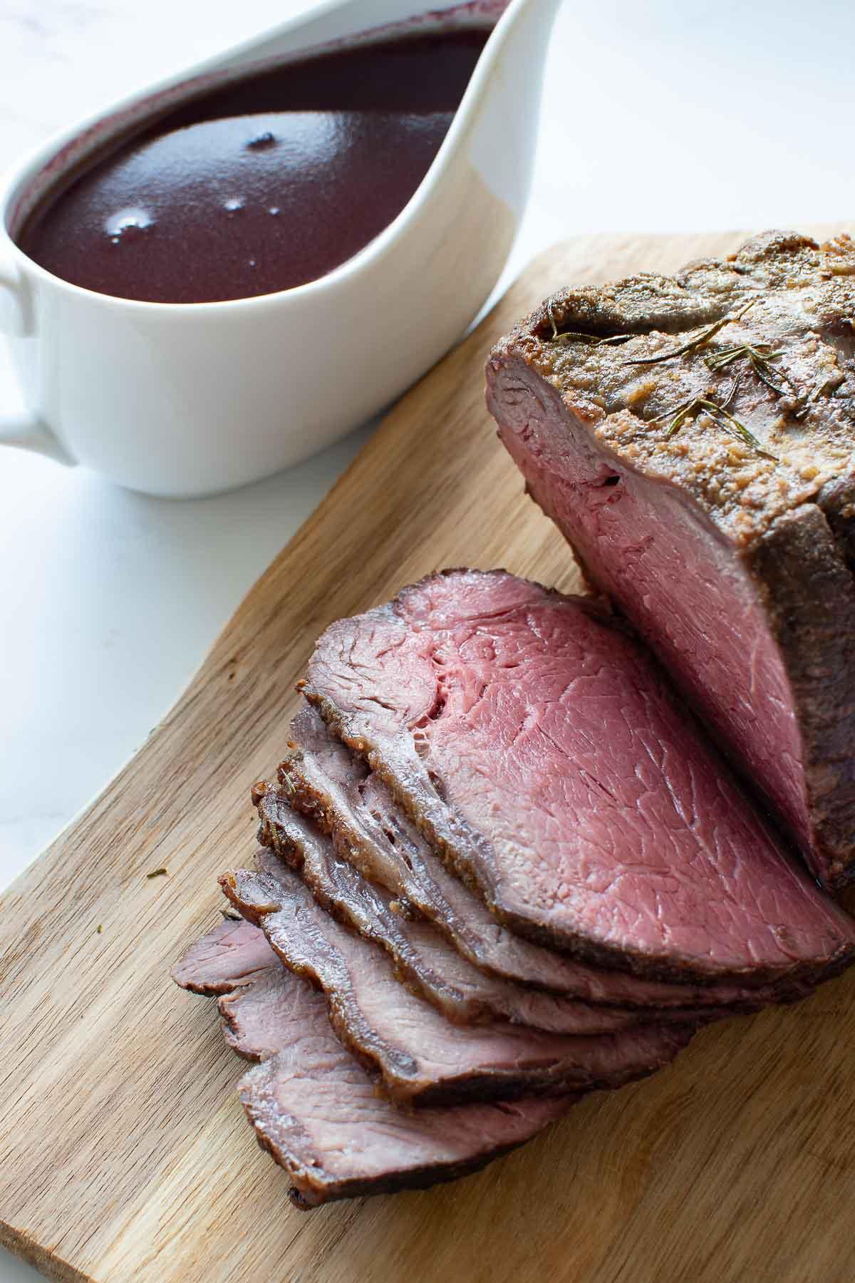 Sliced medium rare roast beef.
