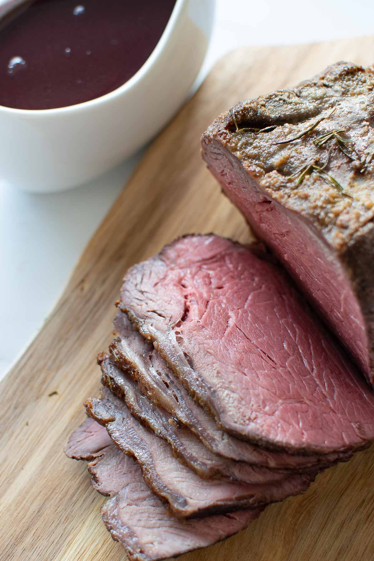 Close up images of medium rare topside of beef.