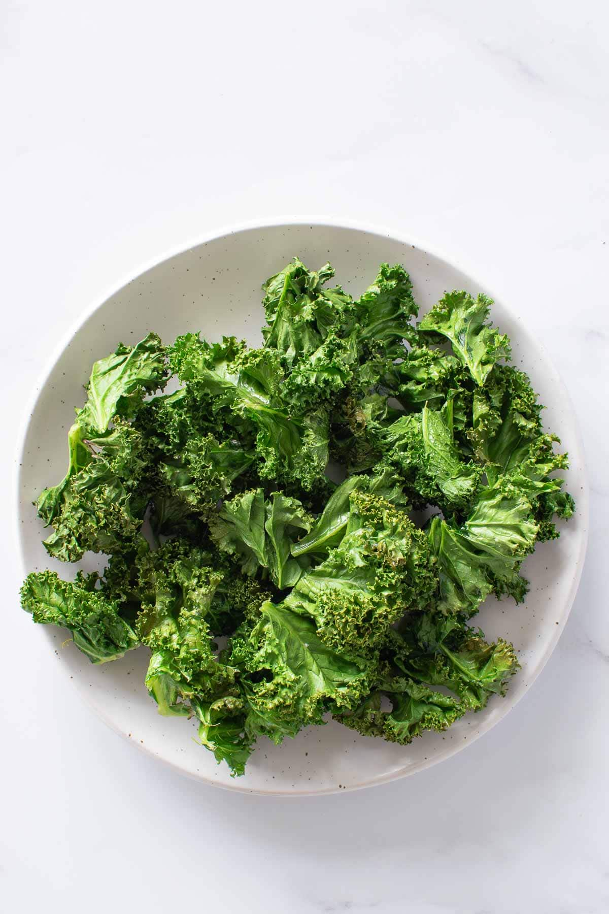 Air Fryer Kale Chips on a plate.