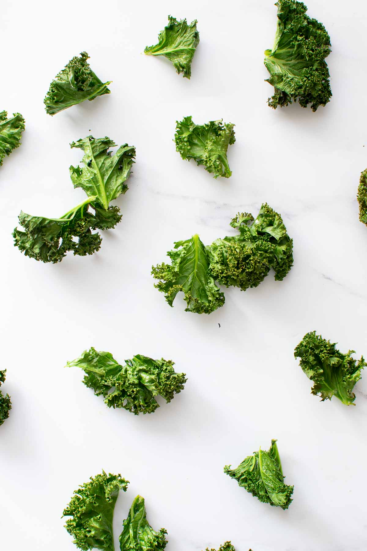 Kale chips scattered on a table.