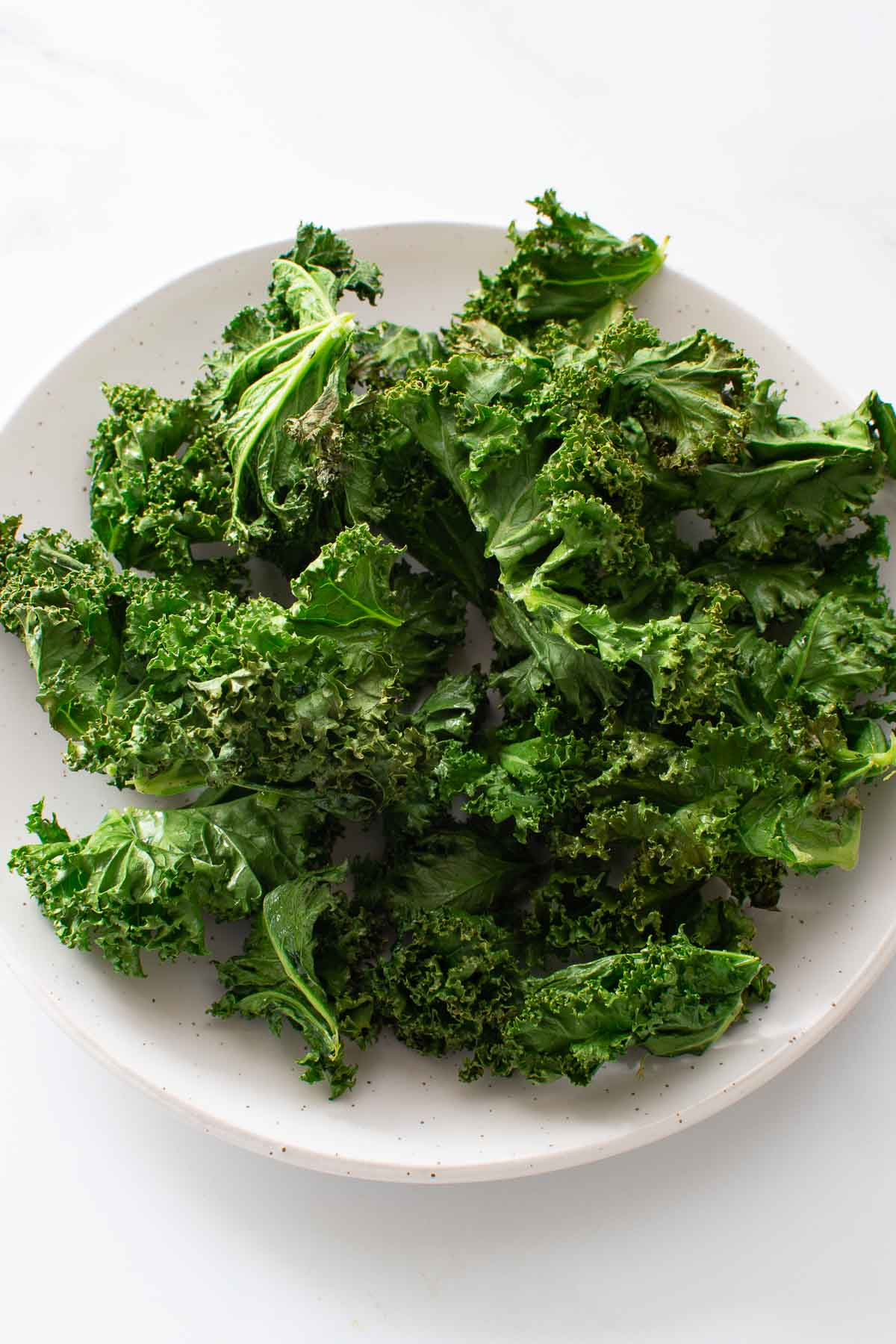 Close up of a plate of kale chips.
