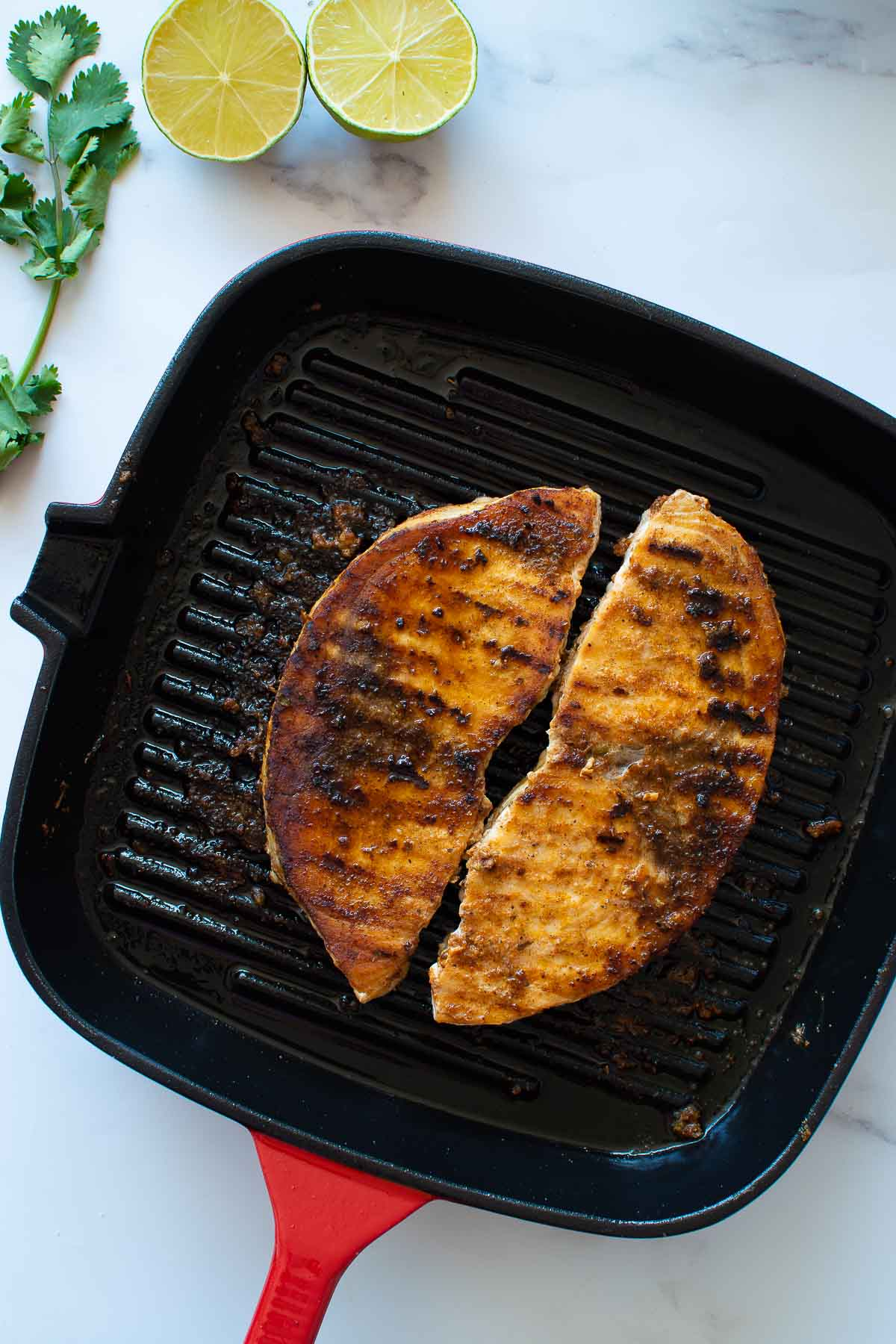 Grilled swordfish in a pan.