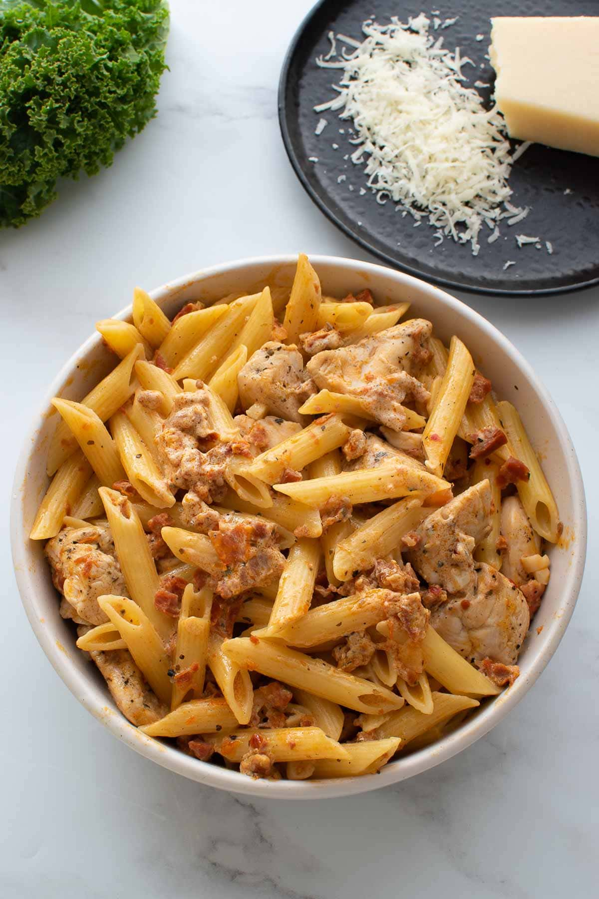 Close up of a bowl of pasta with chicken and chorizo.