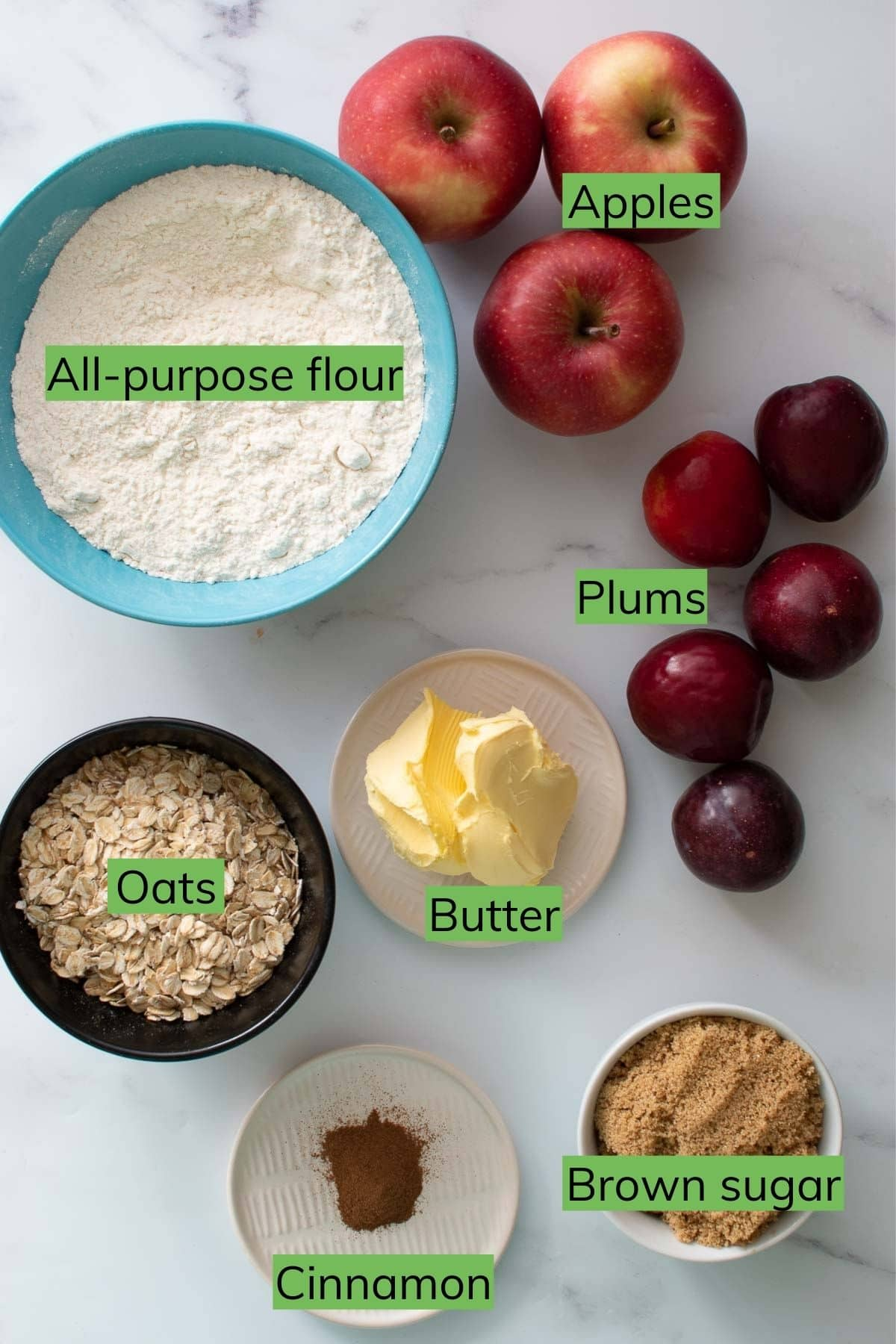 The ingredients needed to make apple plum crumble.