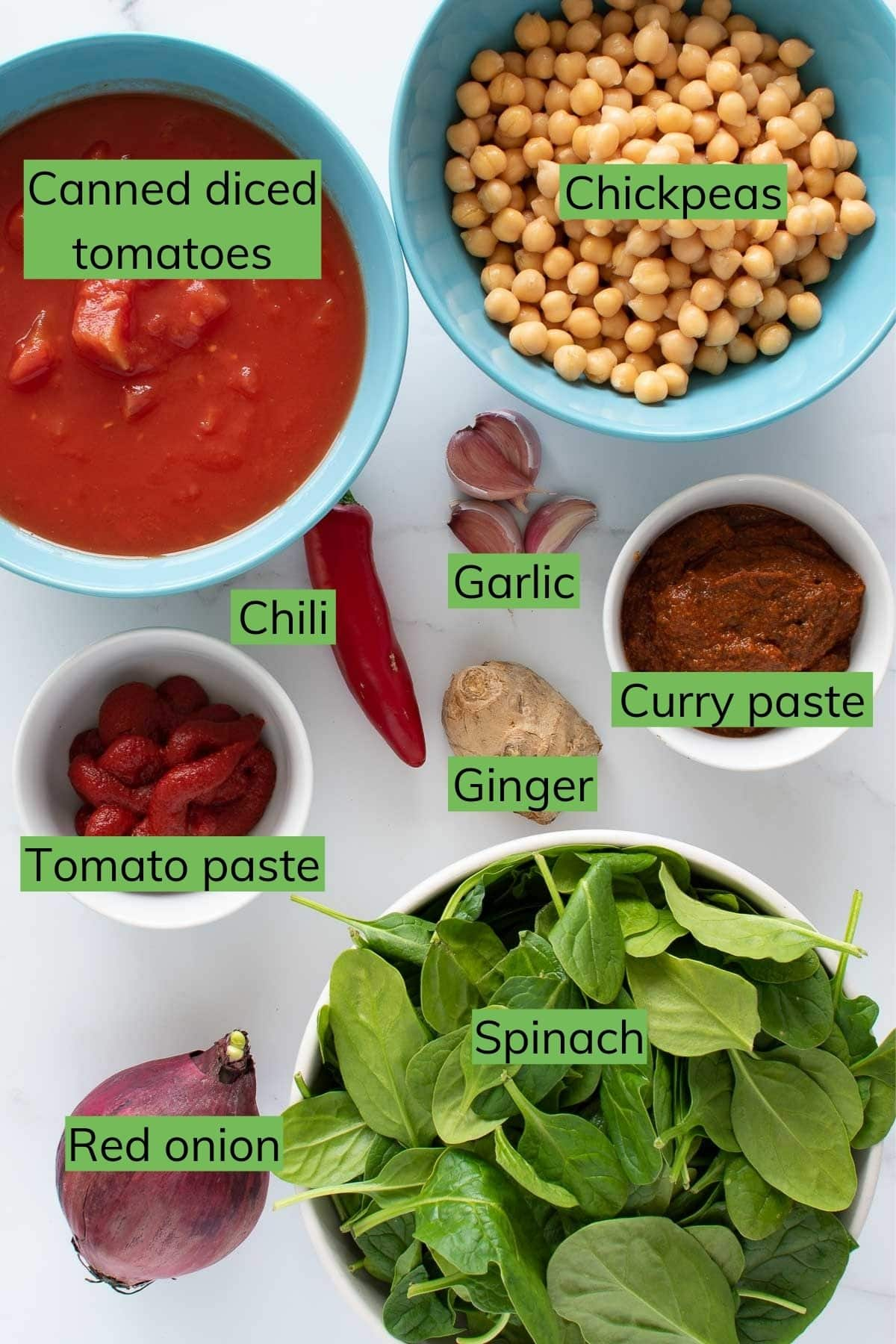 The ingredients needed to make vegetarian curry with spinach and chickpeas.