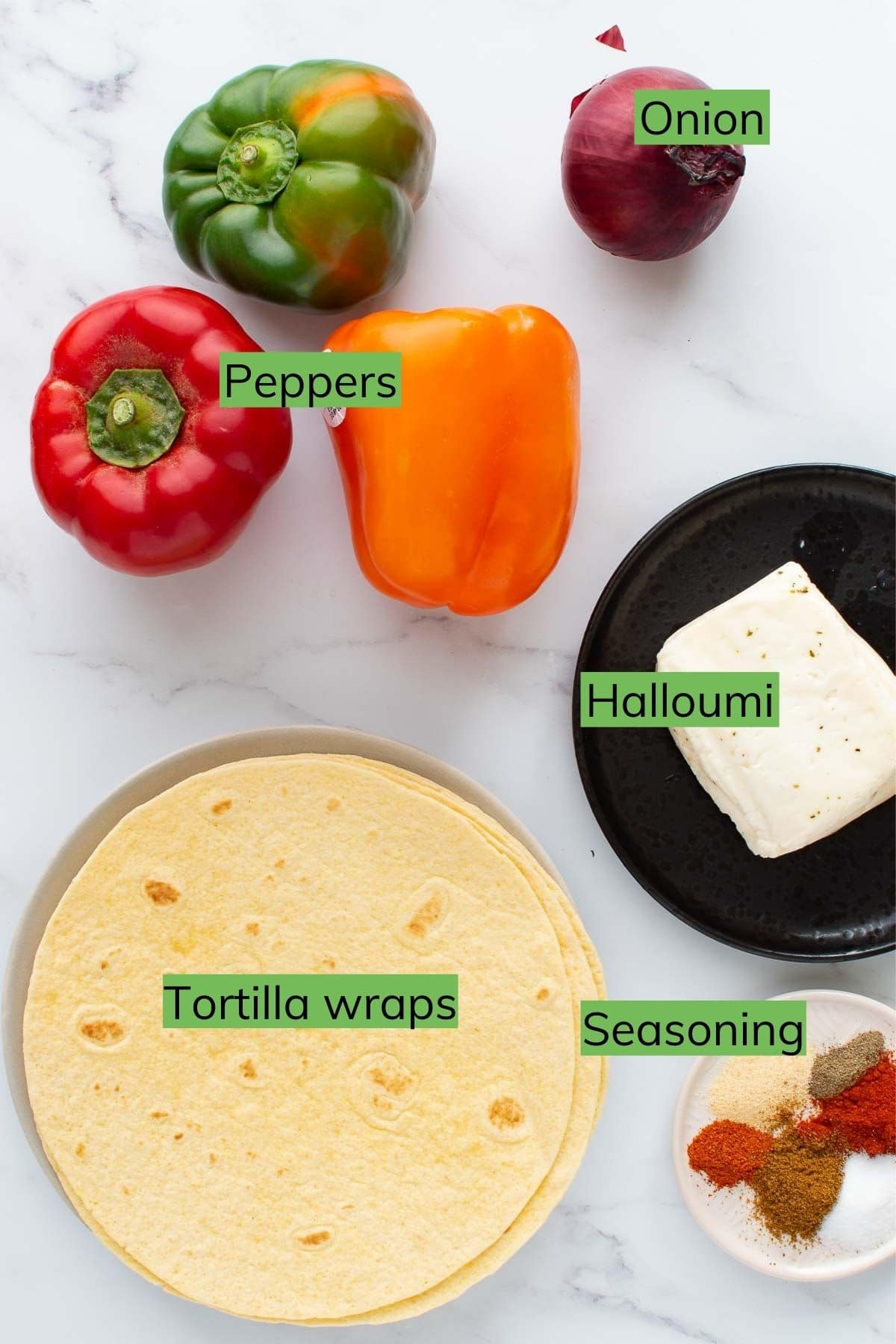 The ingredients needed to make halloumi cheese fajitas laid out on a table.