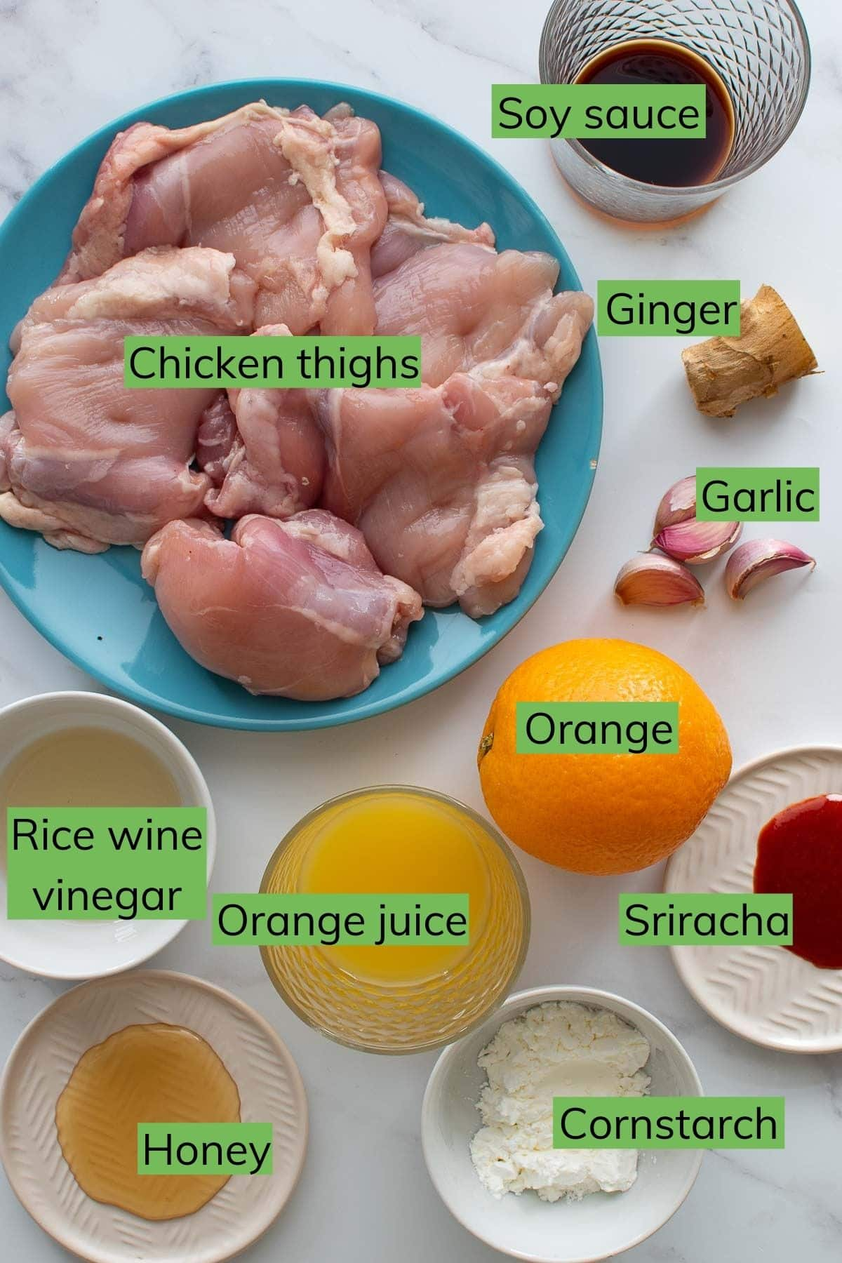 Ingredients for Instant Pot Orange Chicken laid out on a table.