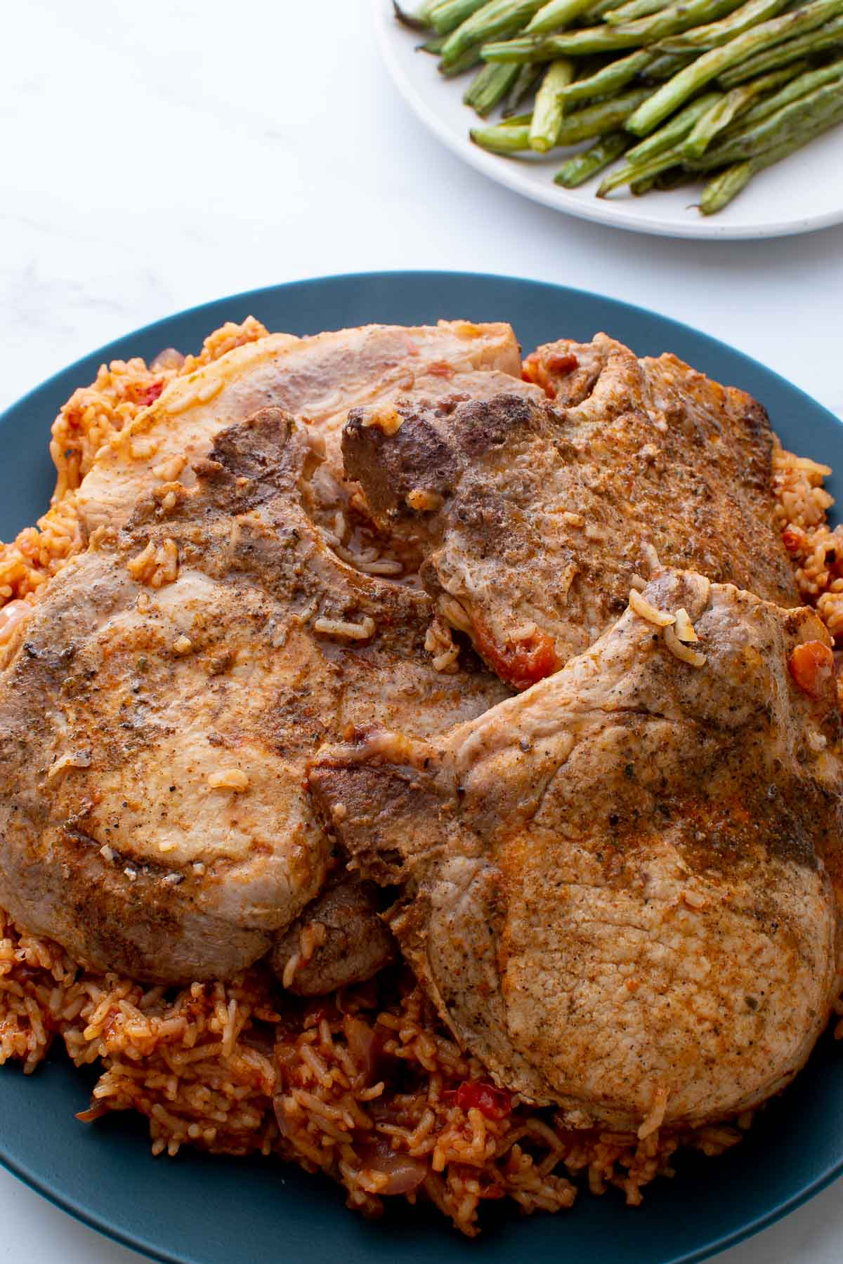 Close up of rice and pork chops.
